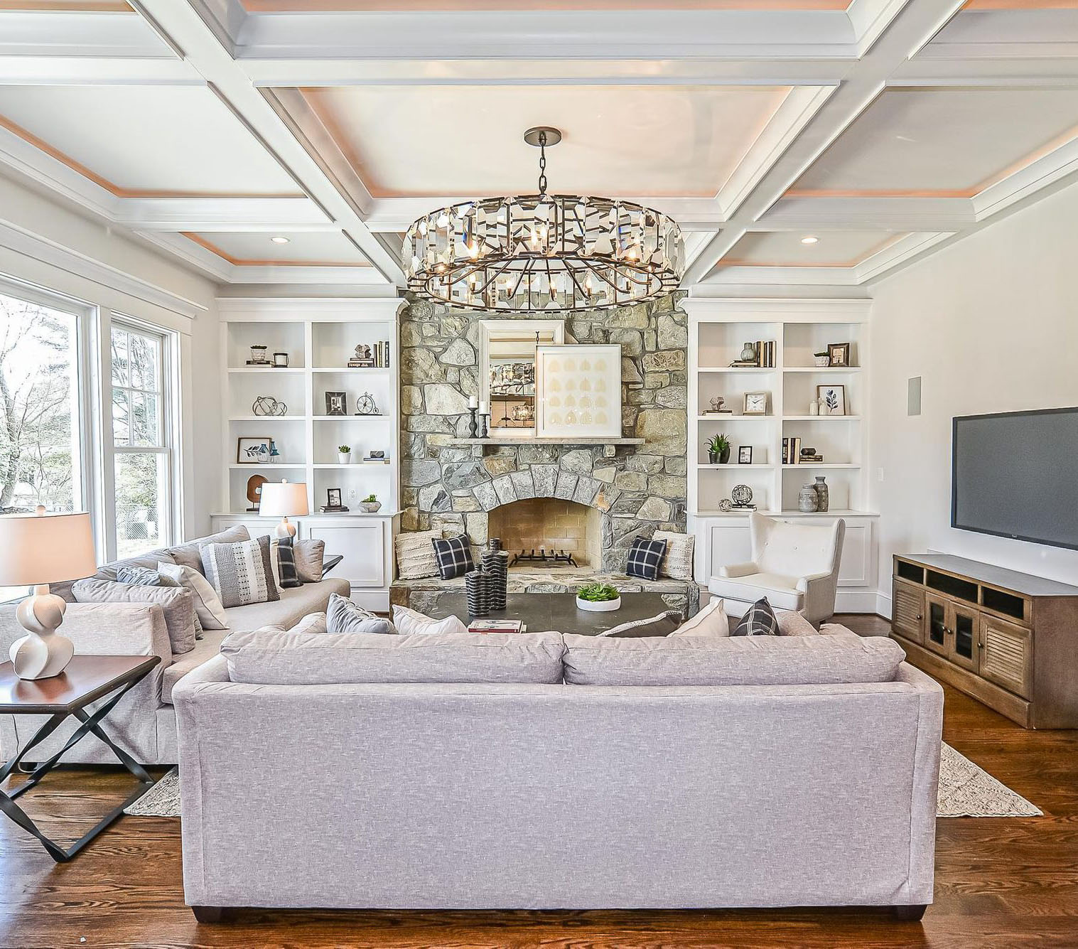 Real stone fireplace surround which has been recessed into the wall surrounded by built ins.