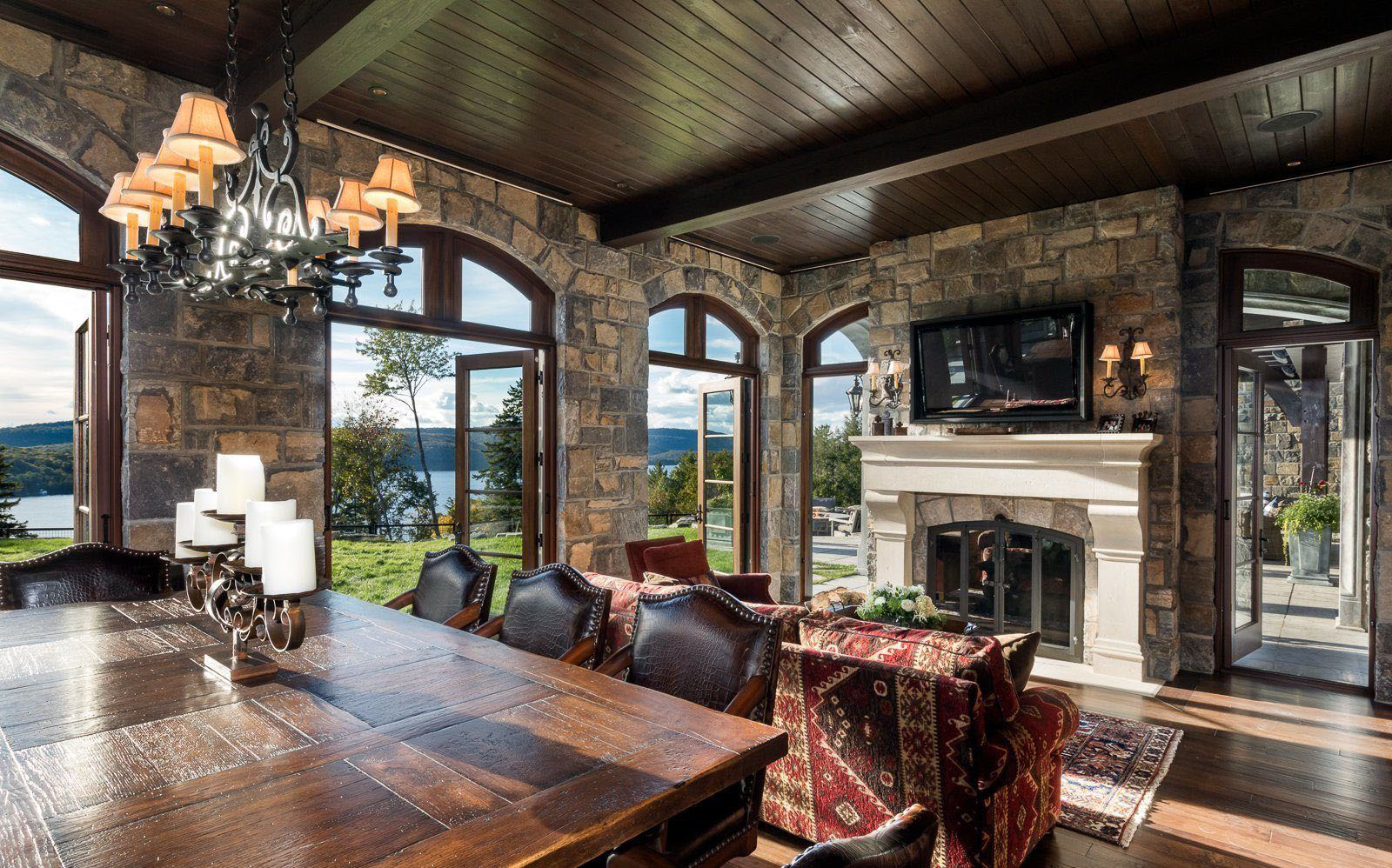 Rustic home with stone interior walls and a cast cement fireplace surround.