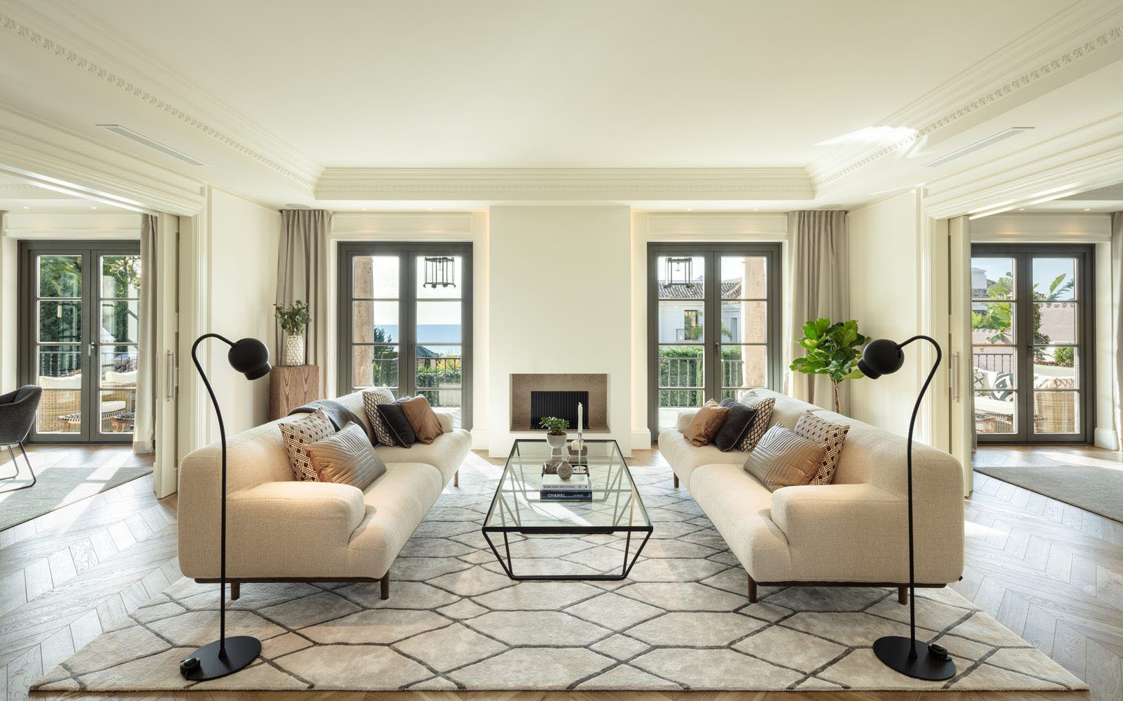 Modern chic living room with a natural warm cream color scheme. Gas fireplace with stone surround.