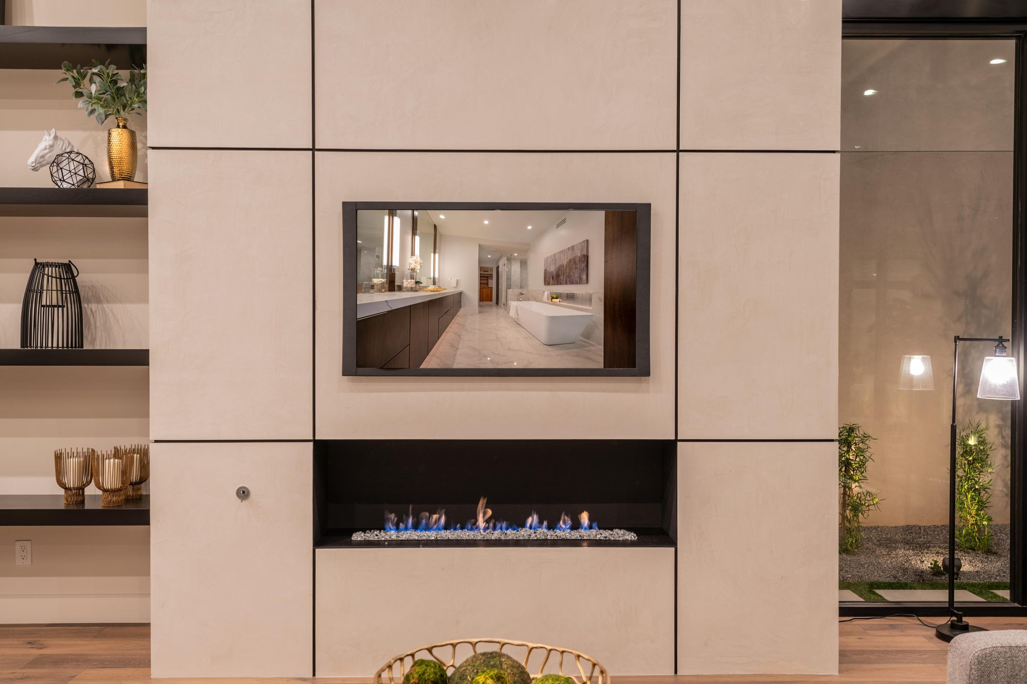 A wide and thin modern fireplace design with grid style panel surround. fireplace design ideas.