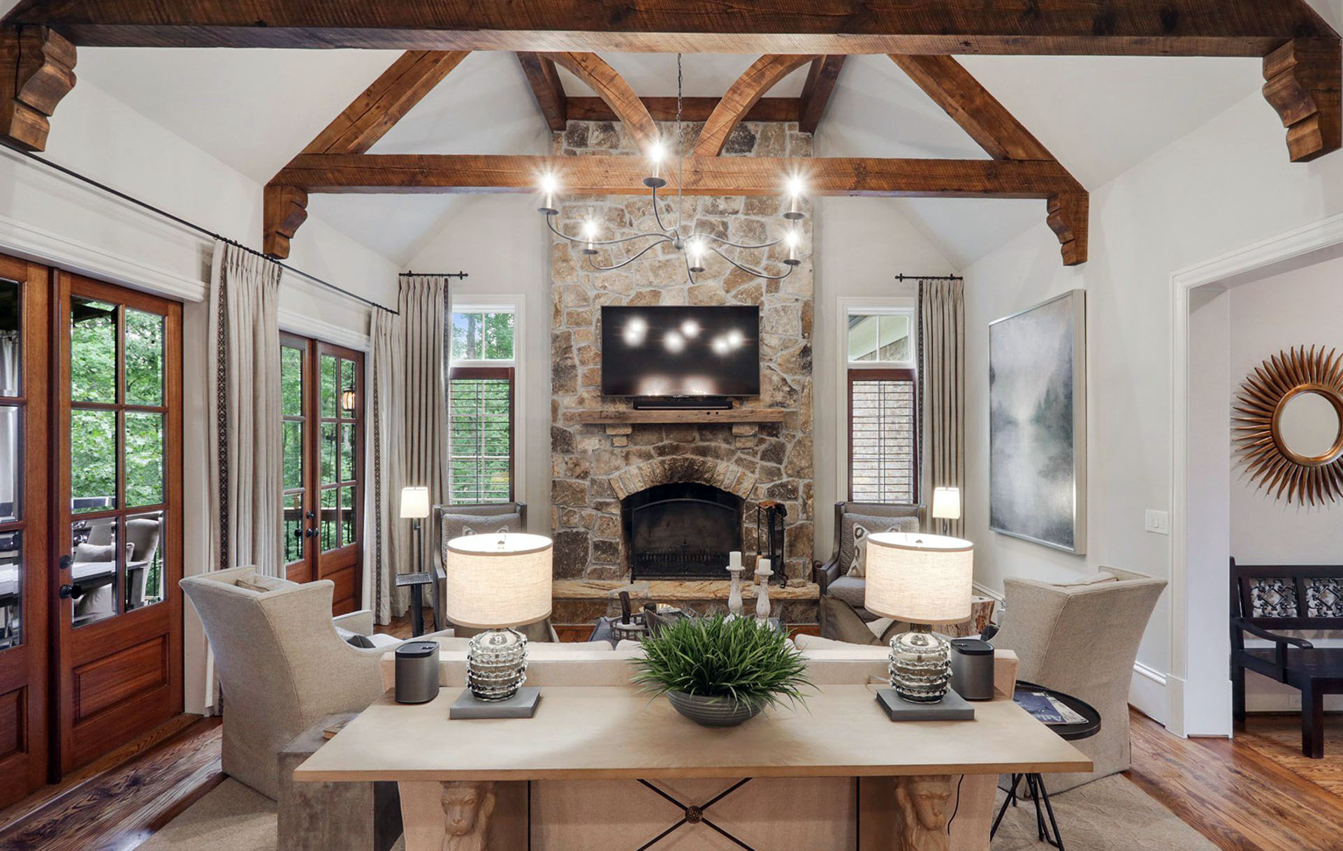 Real stone wood burning fireplace with a wood shelf and flat screen TV.