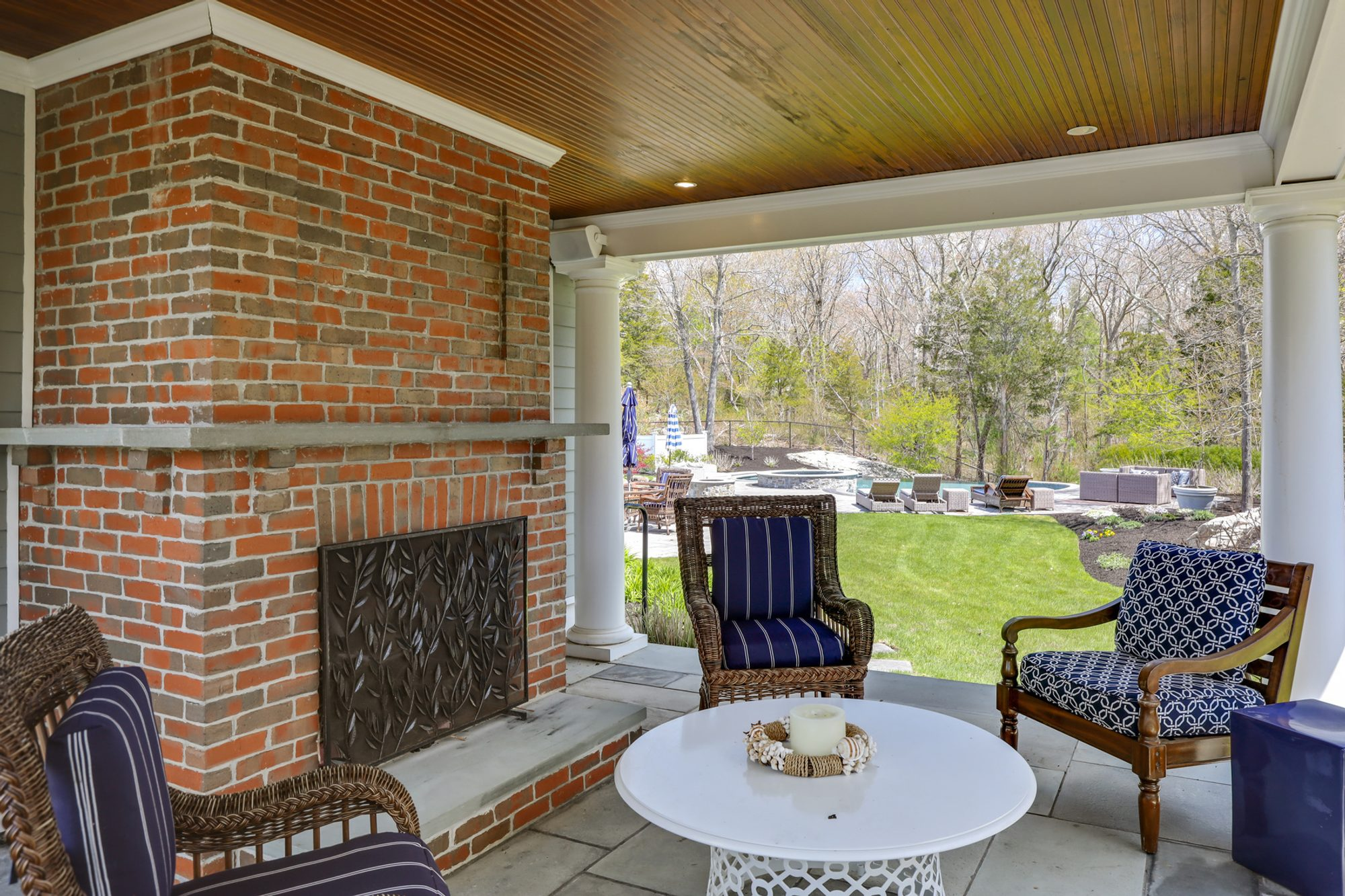 Classic red brick fireplace with a raised limestone hearth and matching mantle. fireplace design ideas.
