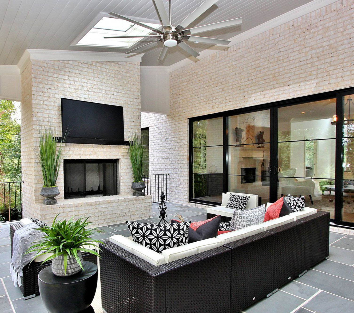 Outdoor red brick fireplace that's been whitewashed with a technique called German Schmear. fireplace design ideas.