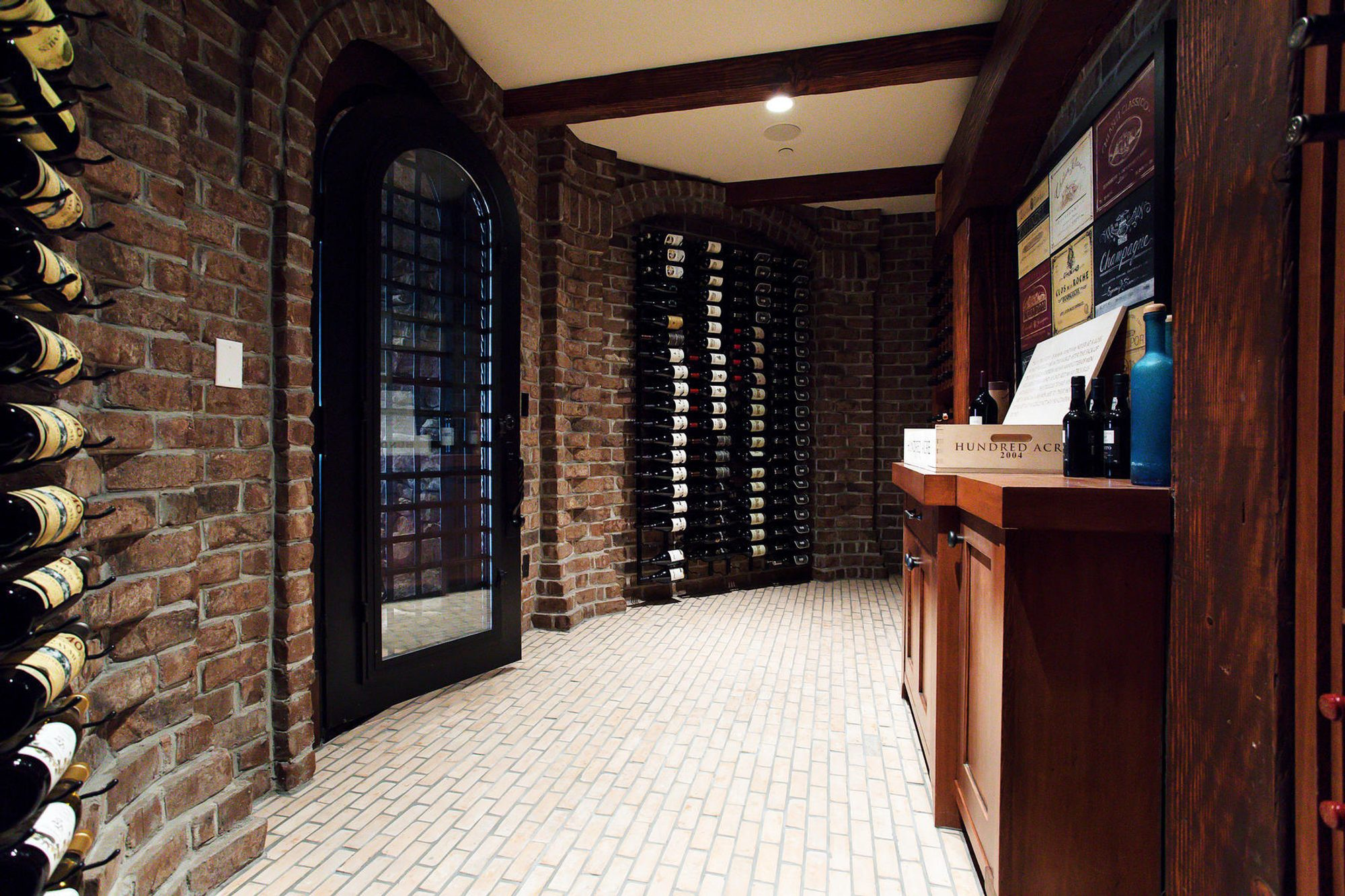 Beautiful wine cellar with red brick walls and dark wood.