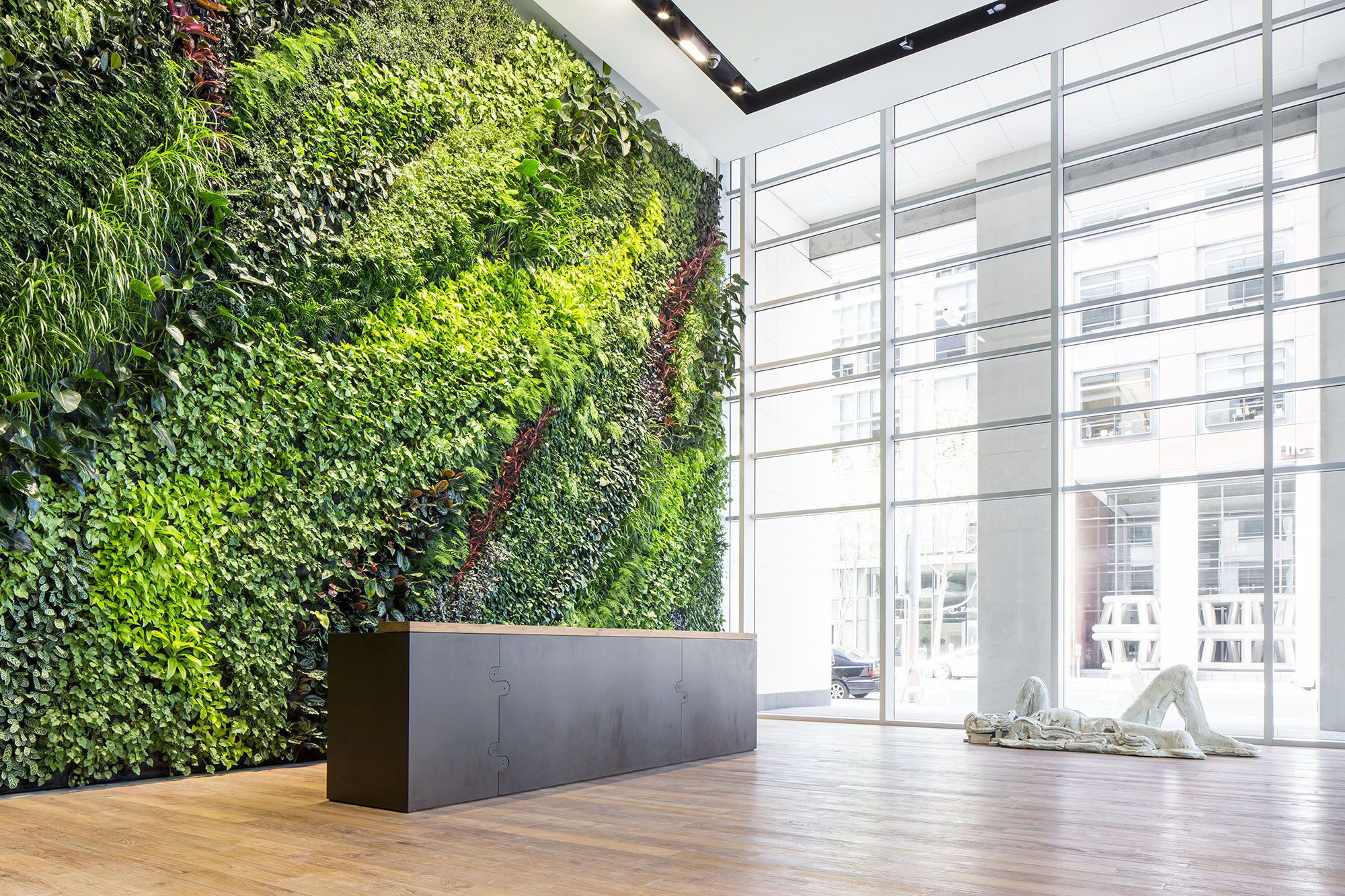 Beautiful two story plant wall behind the front desk.