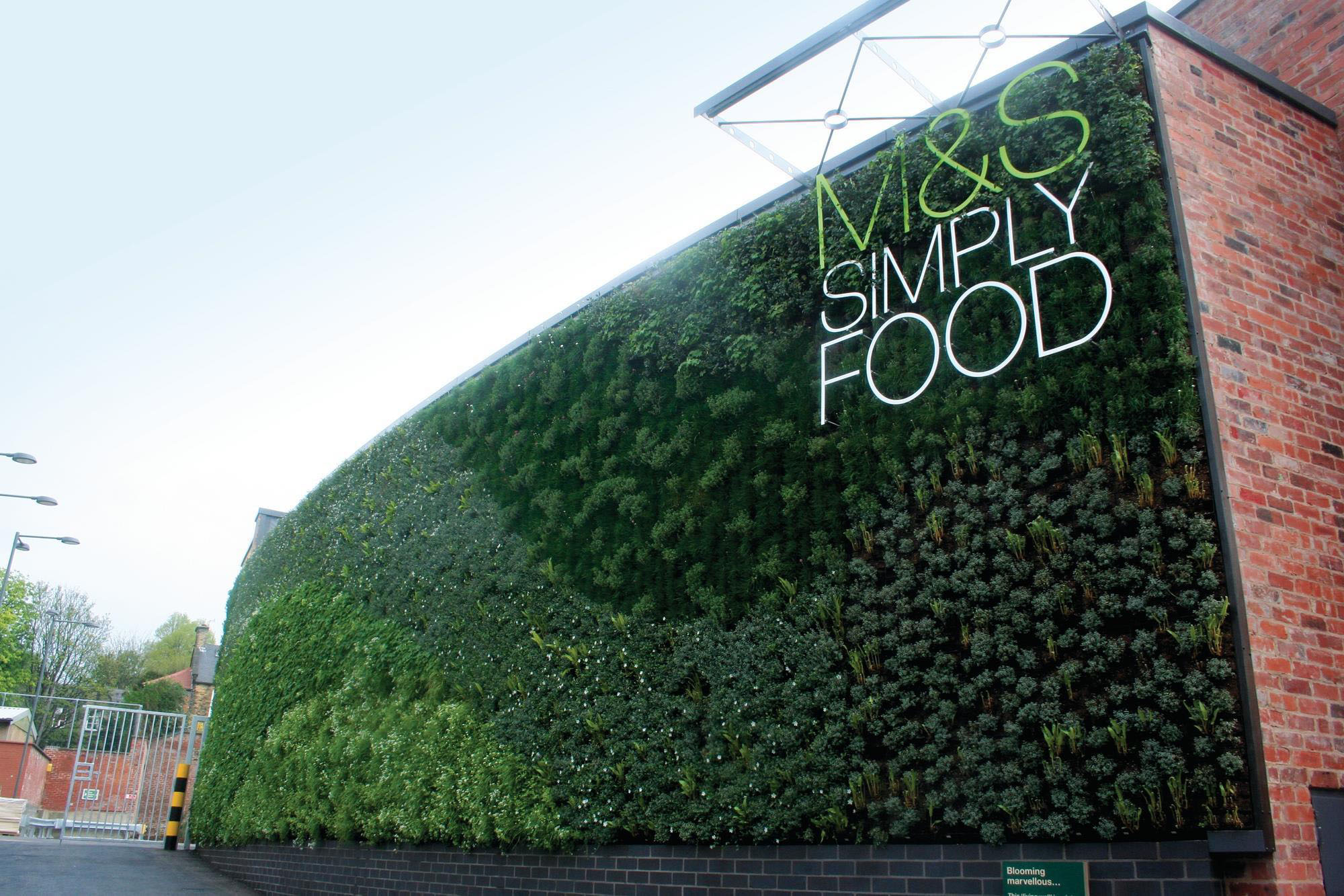 Plant wall on the outside of M&S Simply Food in England.