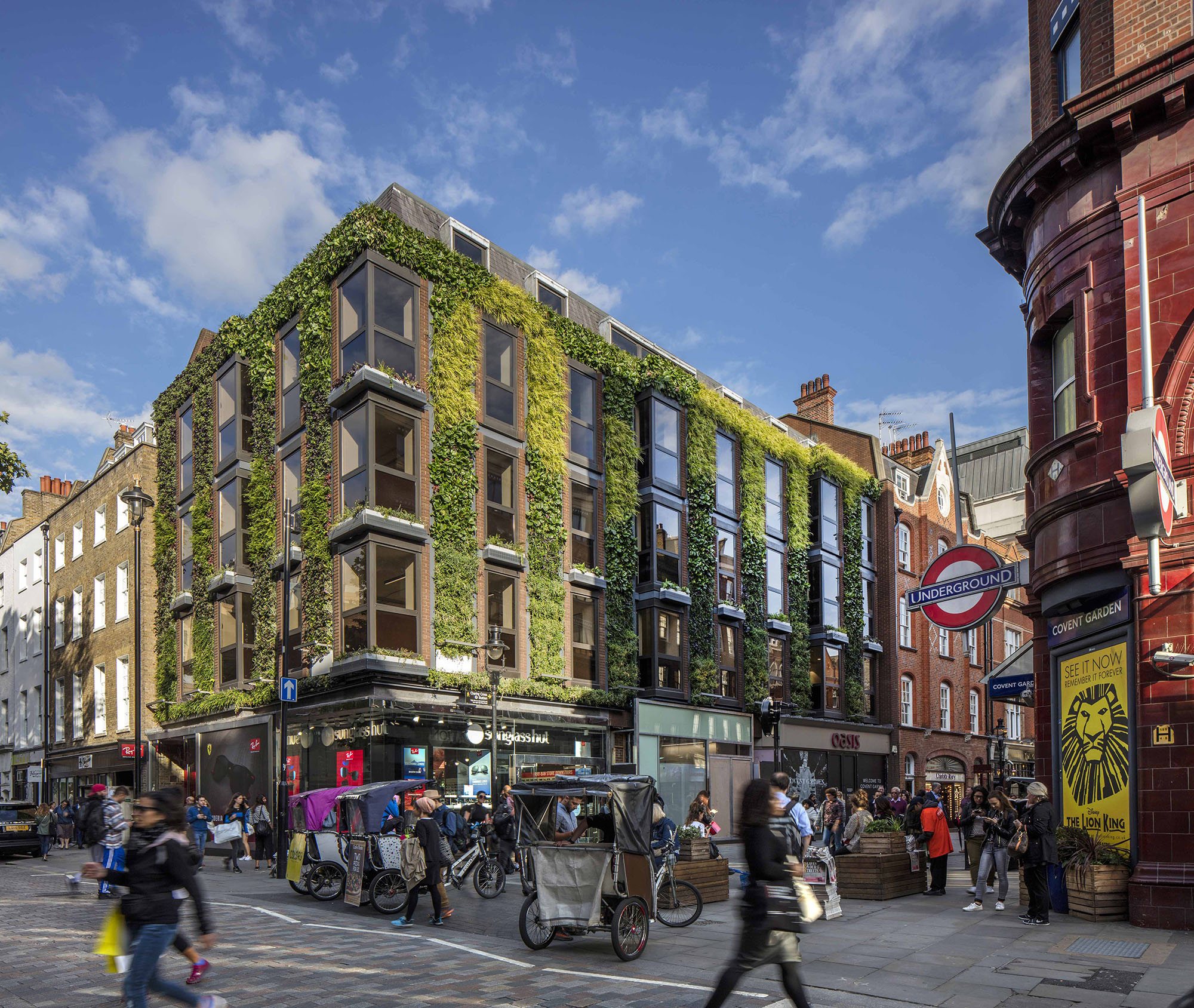 Building in England with living green plant walls.