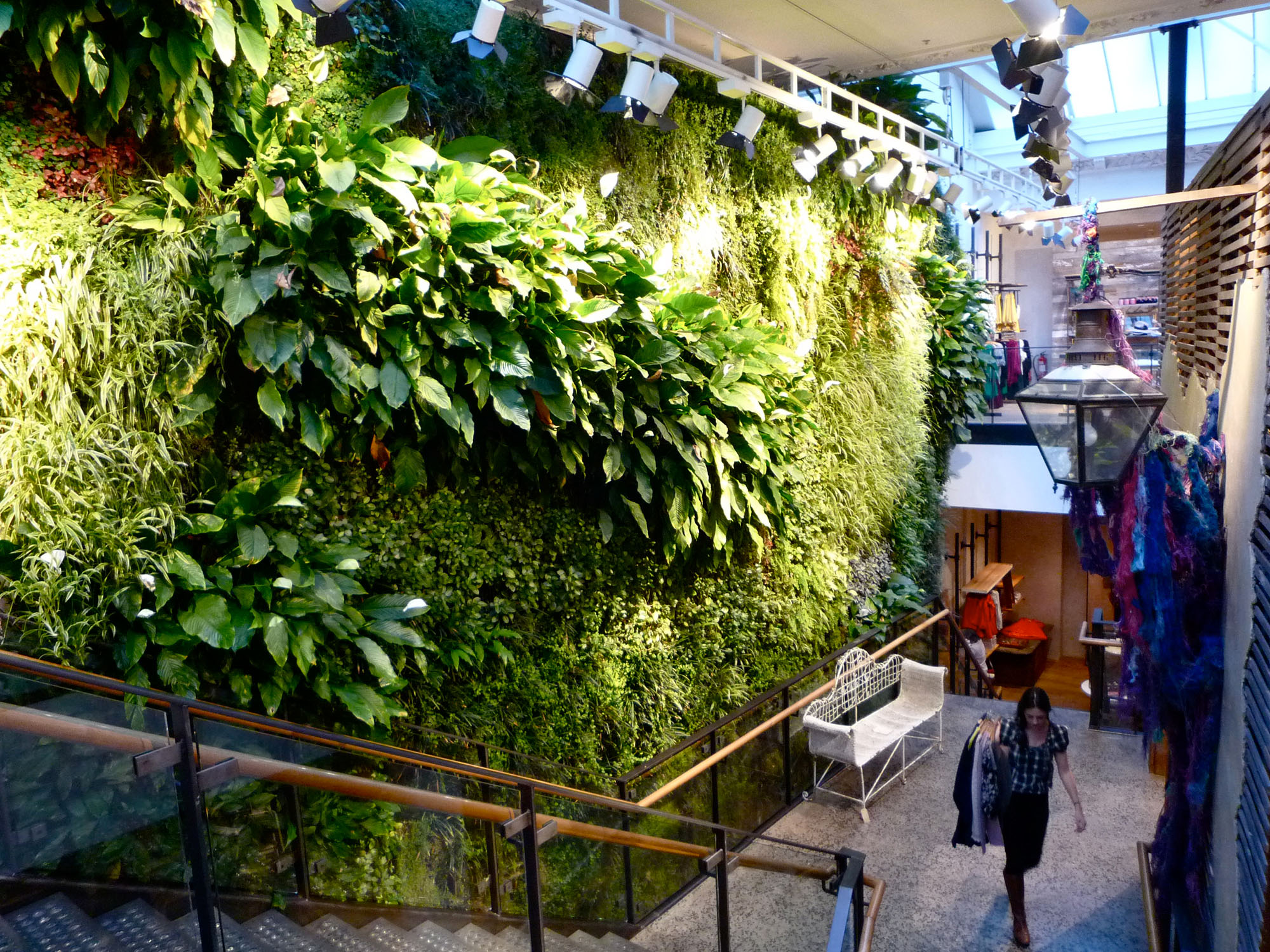Two story living green wall in a clothing store.