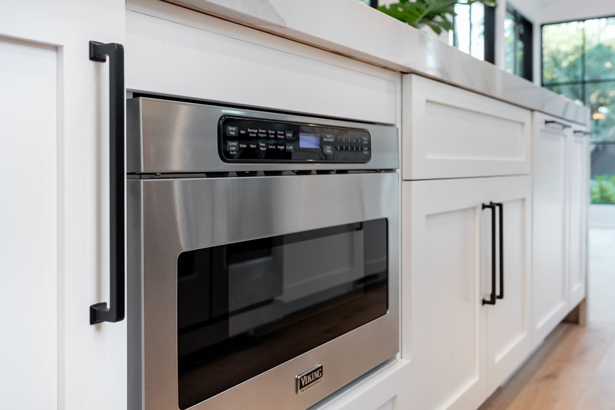 Closeup view of a built in Viking microwave