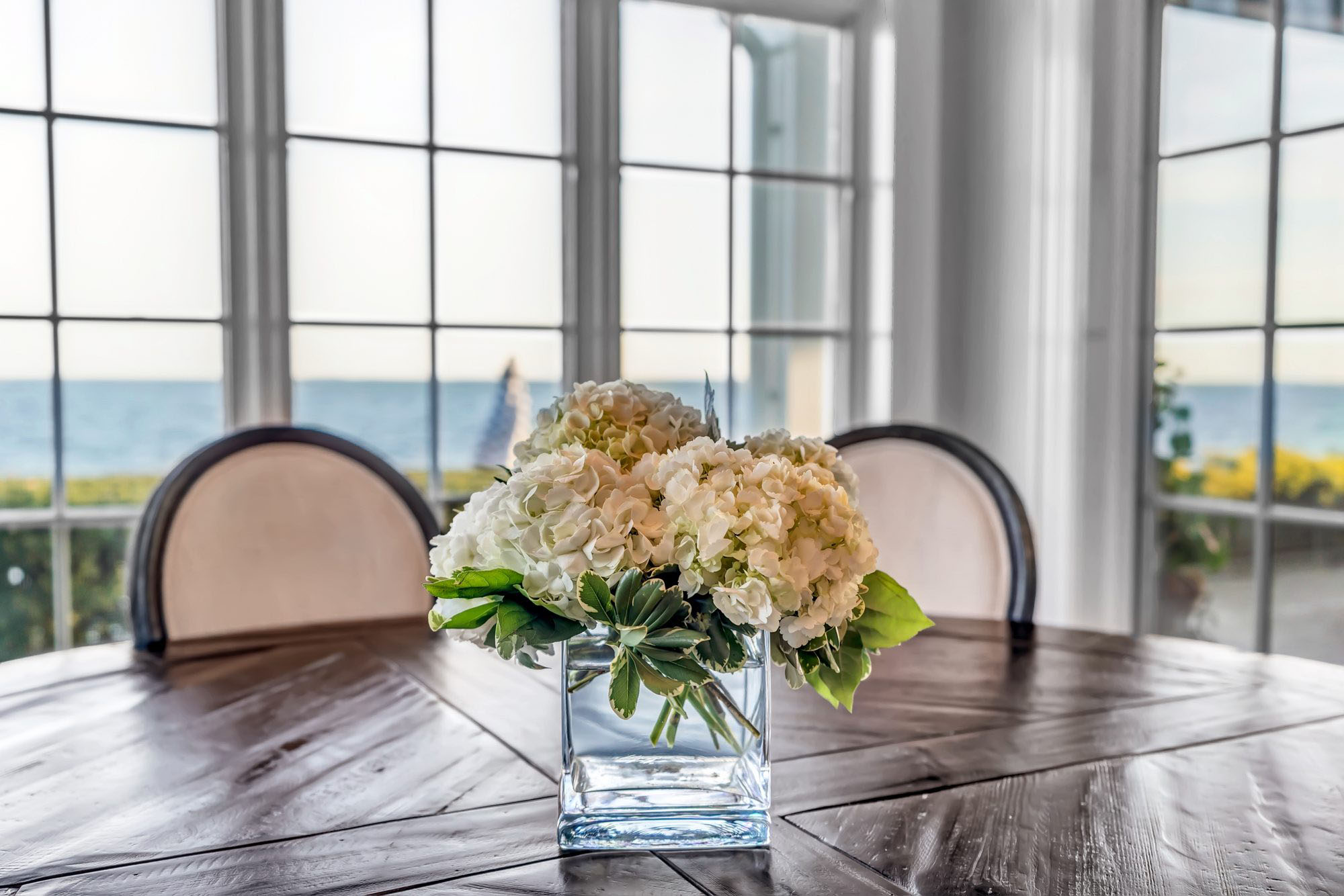 Closeup of a kitchen table with flowers.