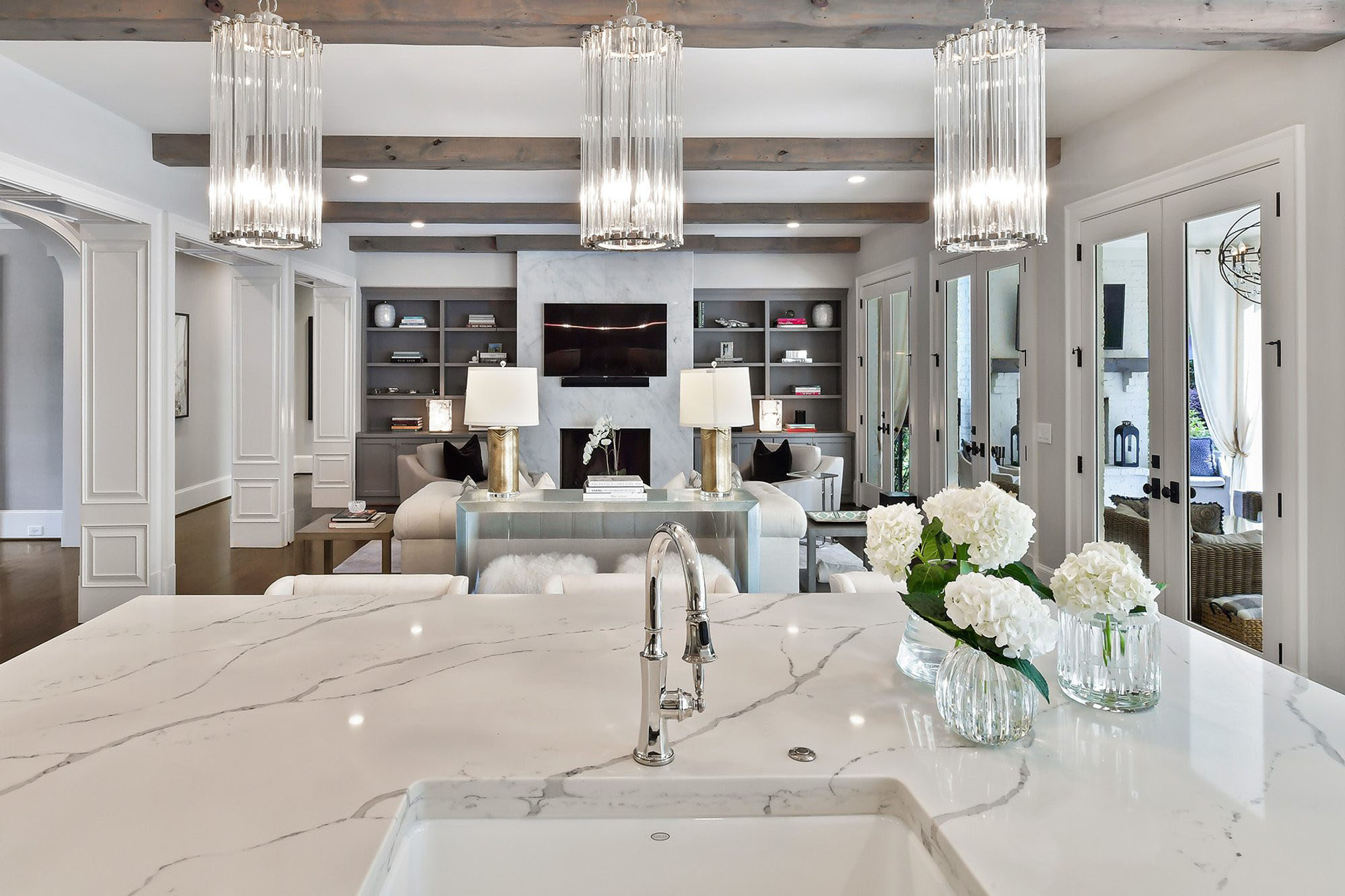 Beautiful marble quartz countertops with a white undermount sink and chrome faucet.