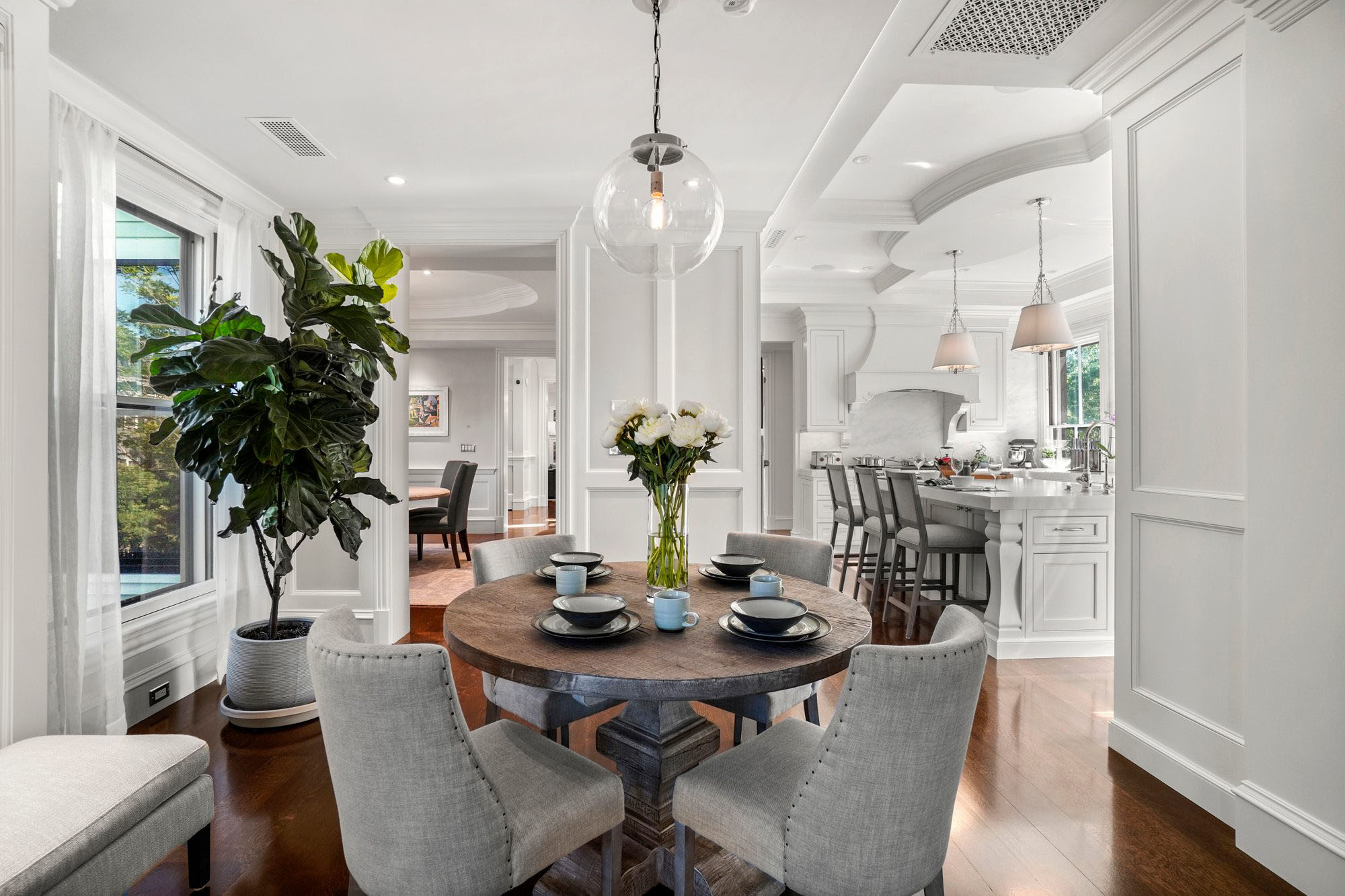 Kitchen seating area with 4 seat round wood table.