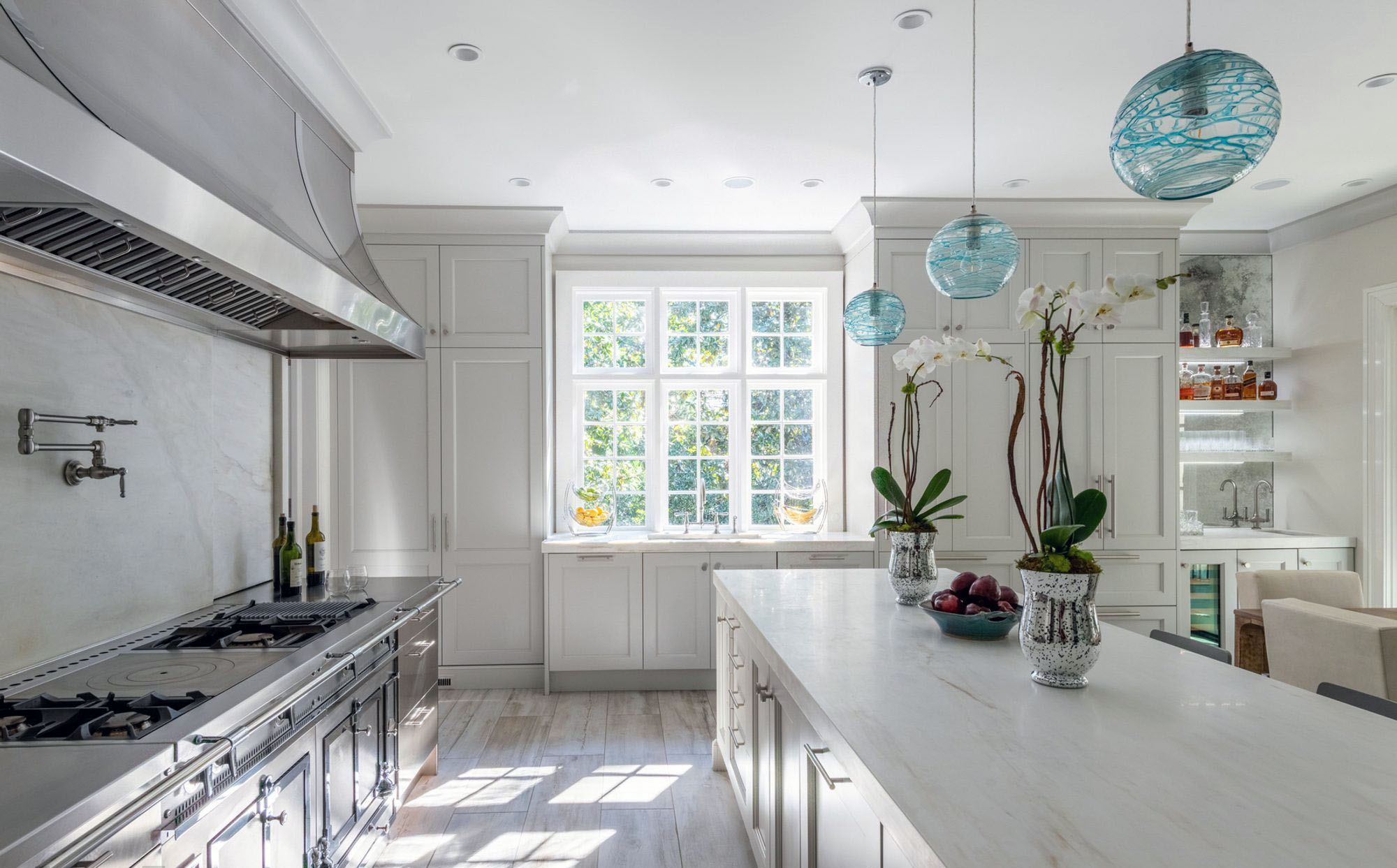 Stunning luxury kitchen with a white and gray color scheme.