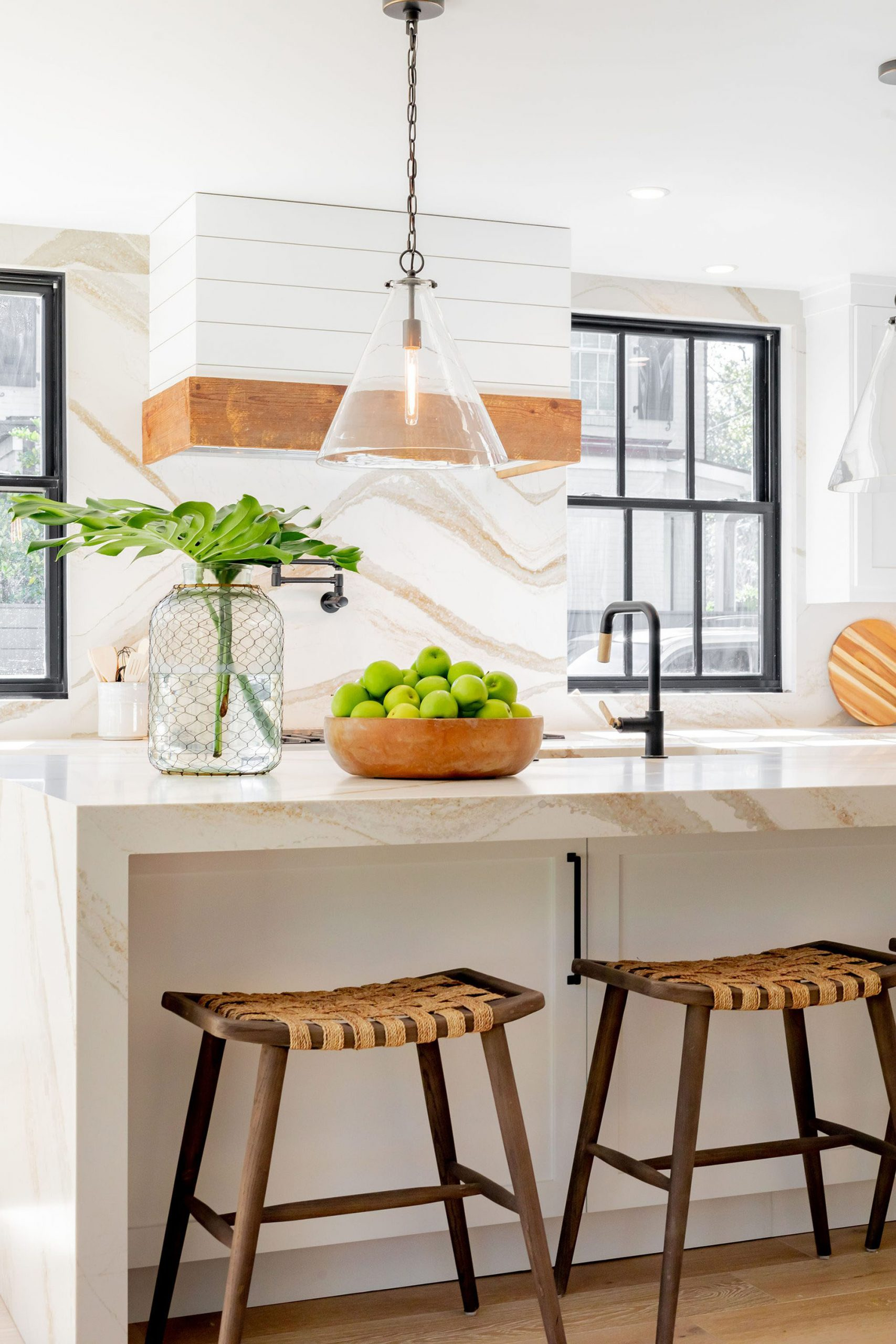 fabulous custom kitchen. solid marble slab counters and backsplash. custom shiplap and wood range hood.