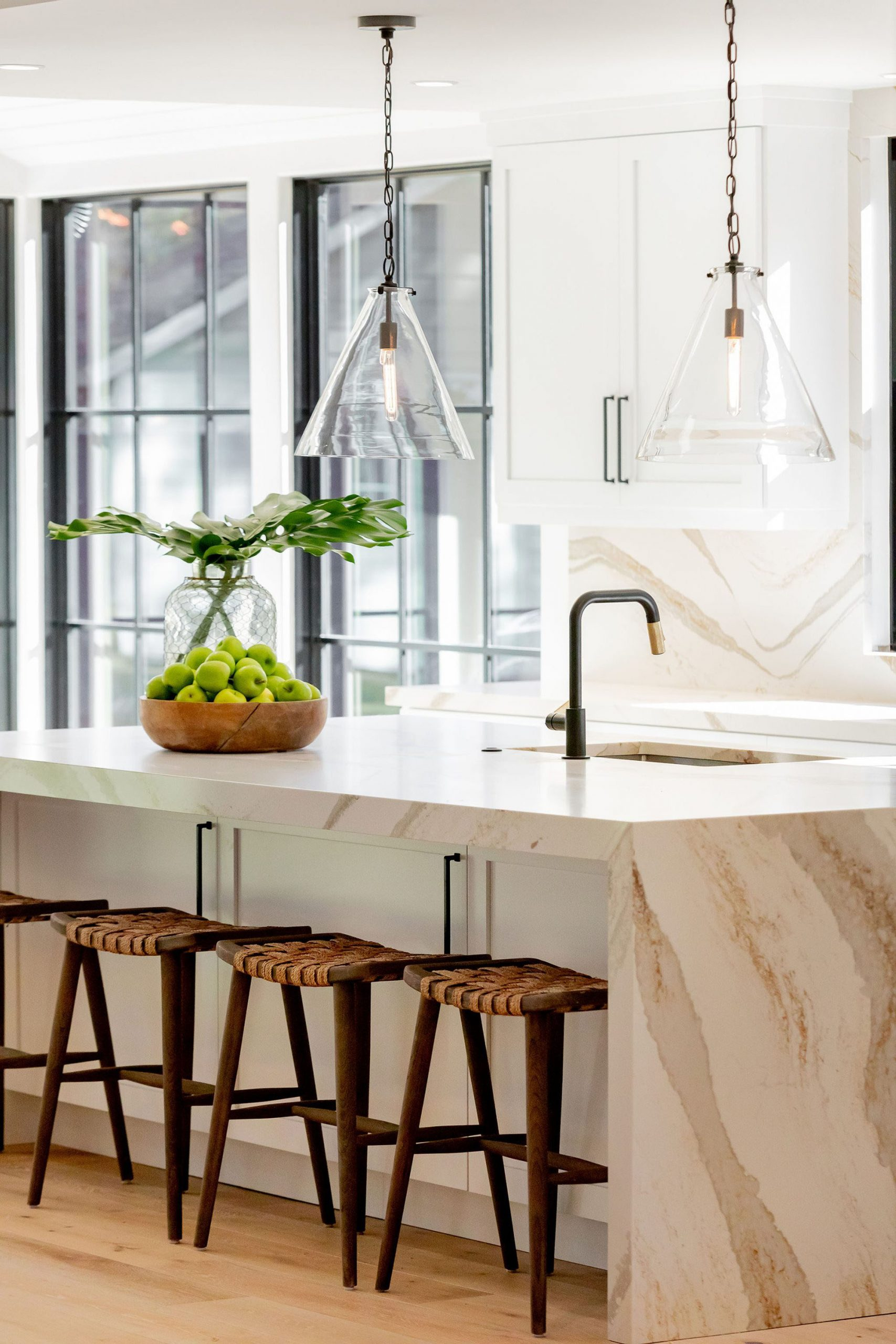 Kitchen island with marble quartz countertop and matching sides.