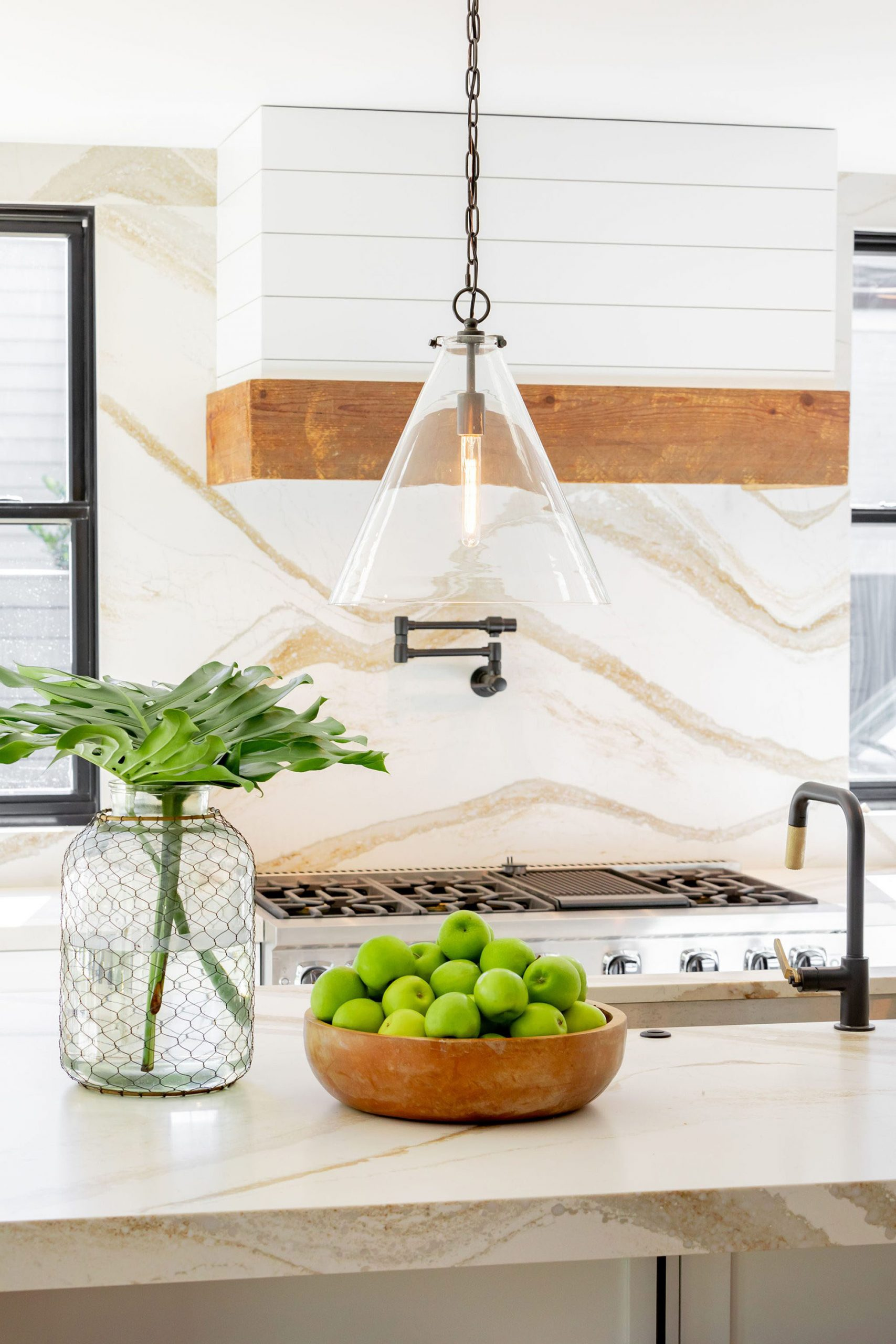 Closeup of a clear glass country style pendant light with chain.