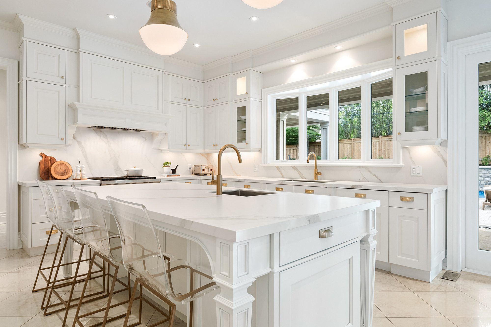White kitchen cabinets with a matching white island.
