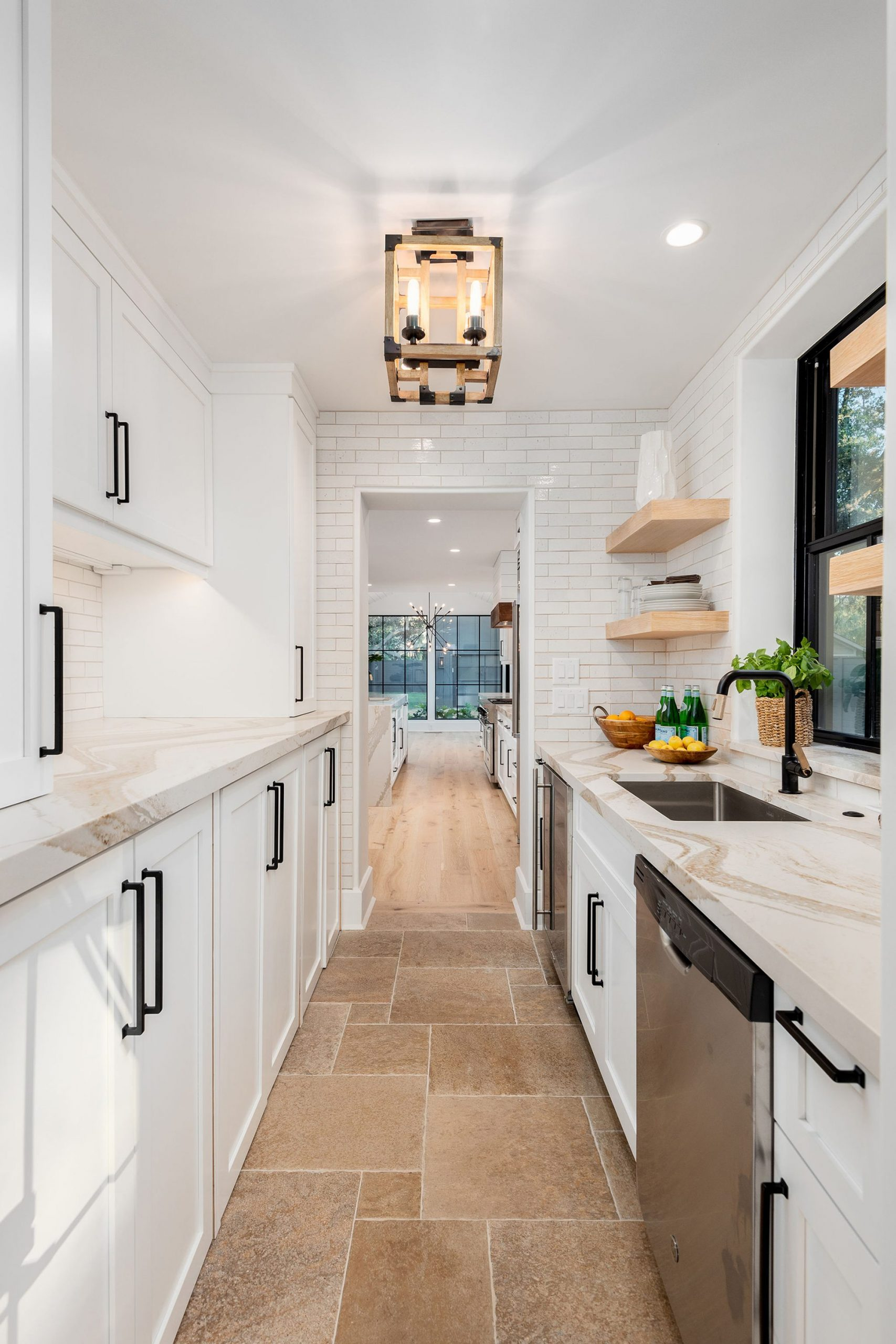 All white prep kitchen with white subway tiled walls.