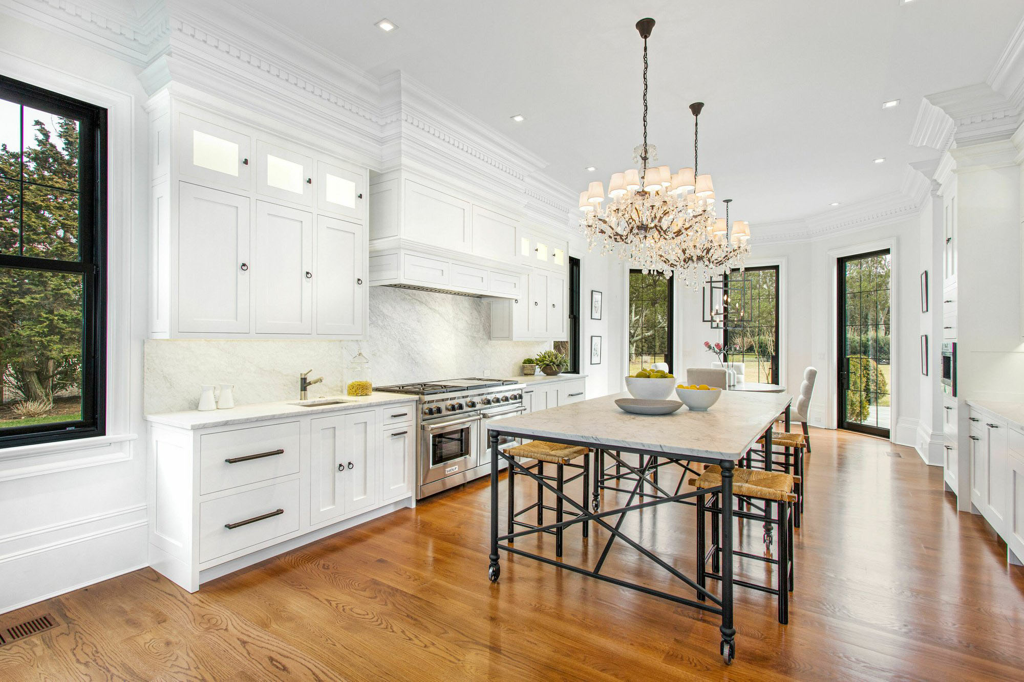 Beautiful classic kitchen design featuring thick crown molding tied into the upper cabinets.