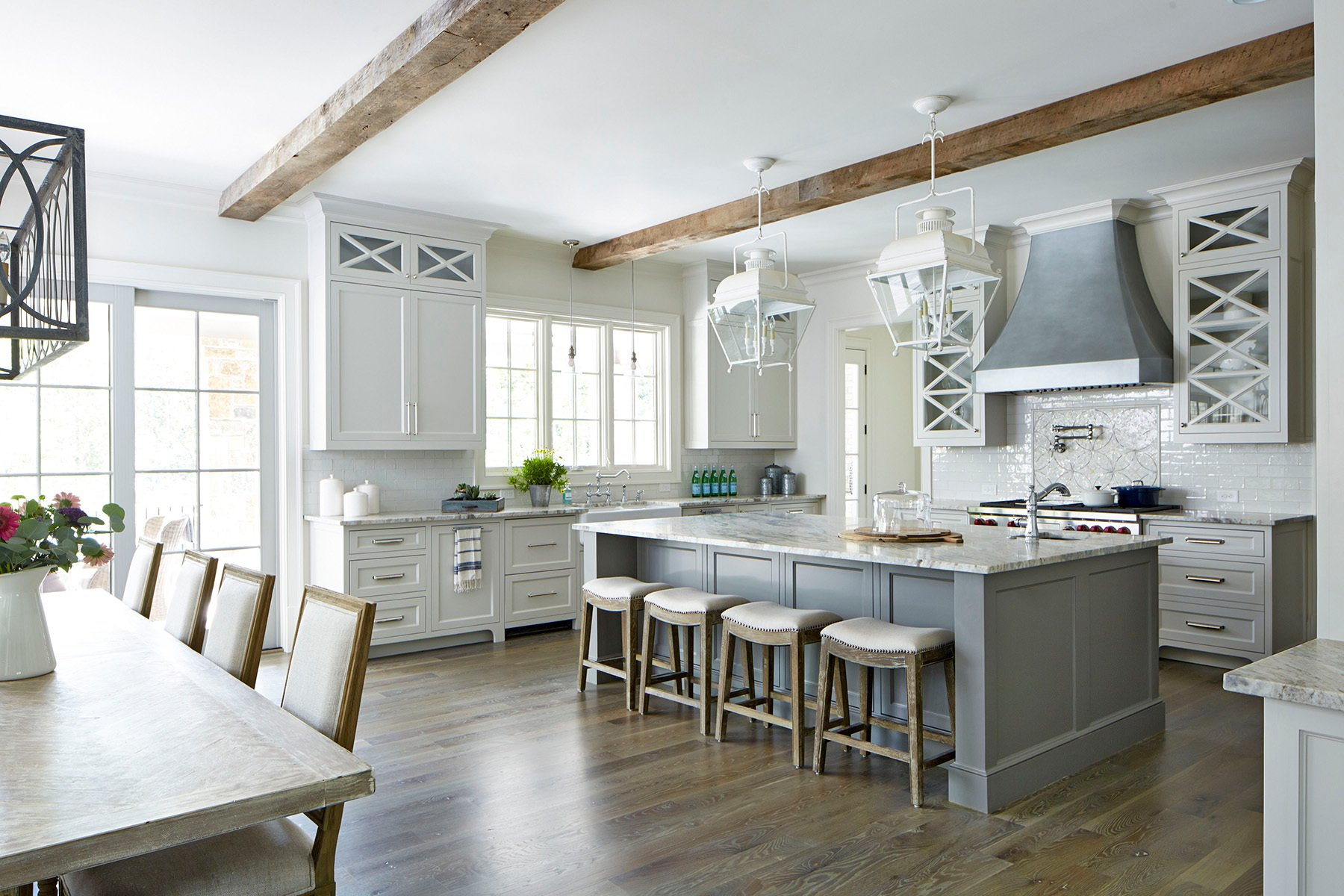Traditional style kitchen with white cabinets and a gray center island.