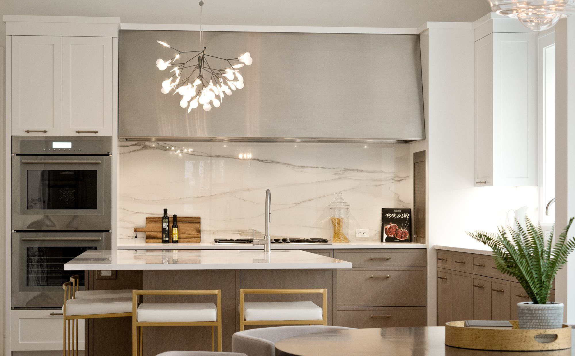 Beautiful Modern style kitchen with a built in stainless steel convection oven. what's a convection oiven.