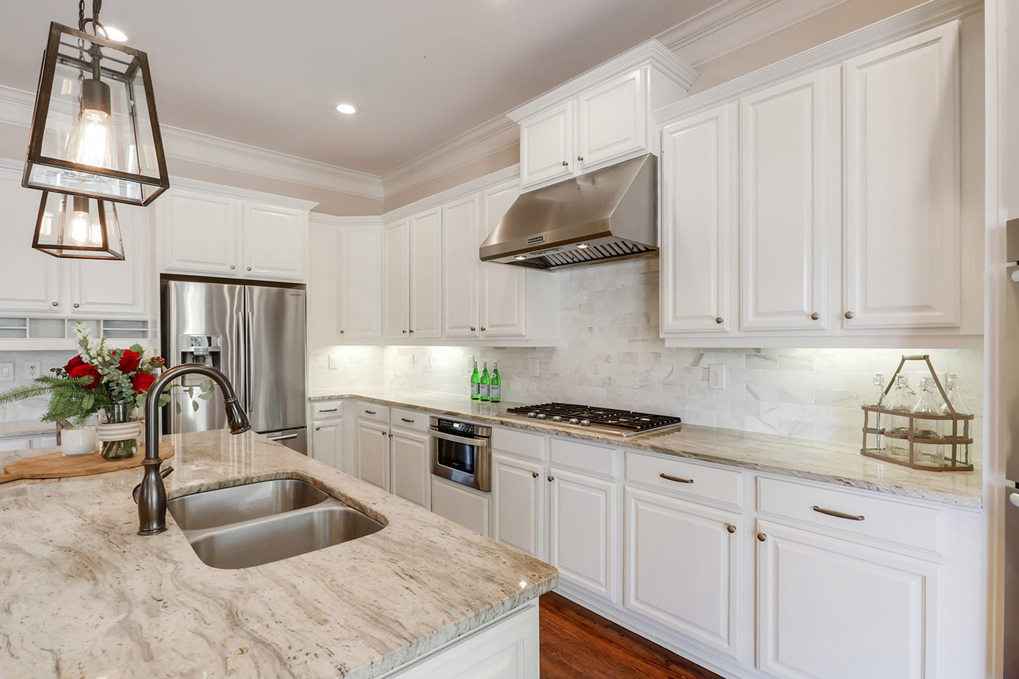 White marble tile kitchen backsplash with unsanded bright white grout.