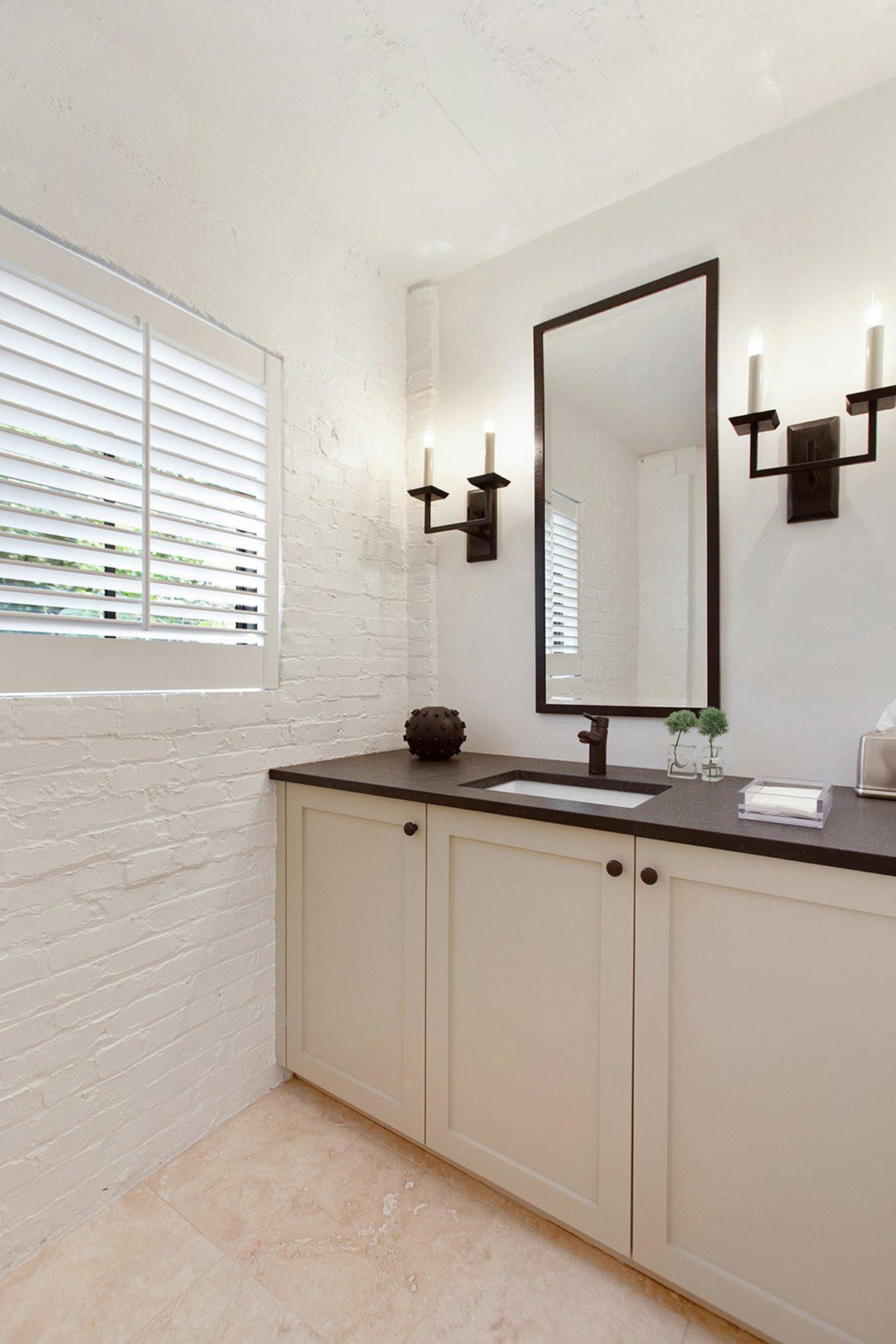 Painted white brick walls inside a bathroom.