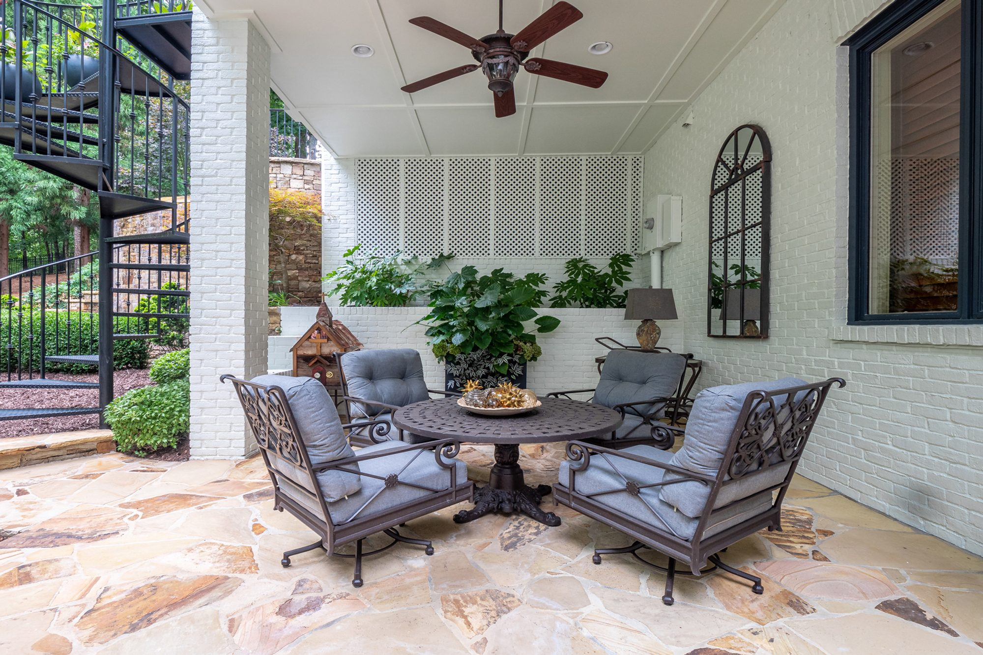 Covered back patio with painted white brick walls and columns.