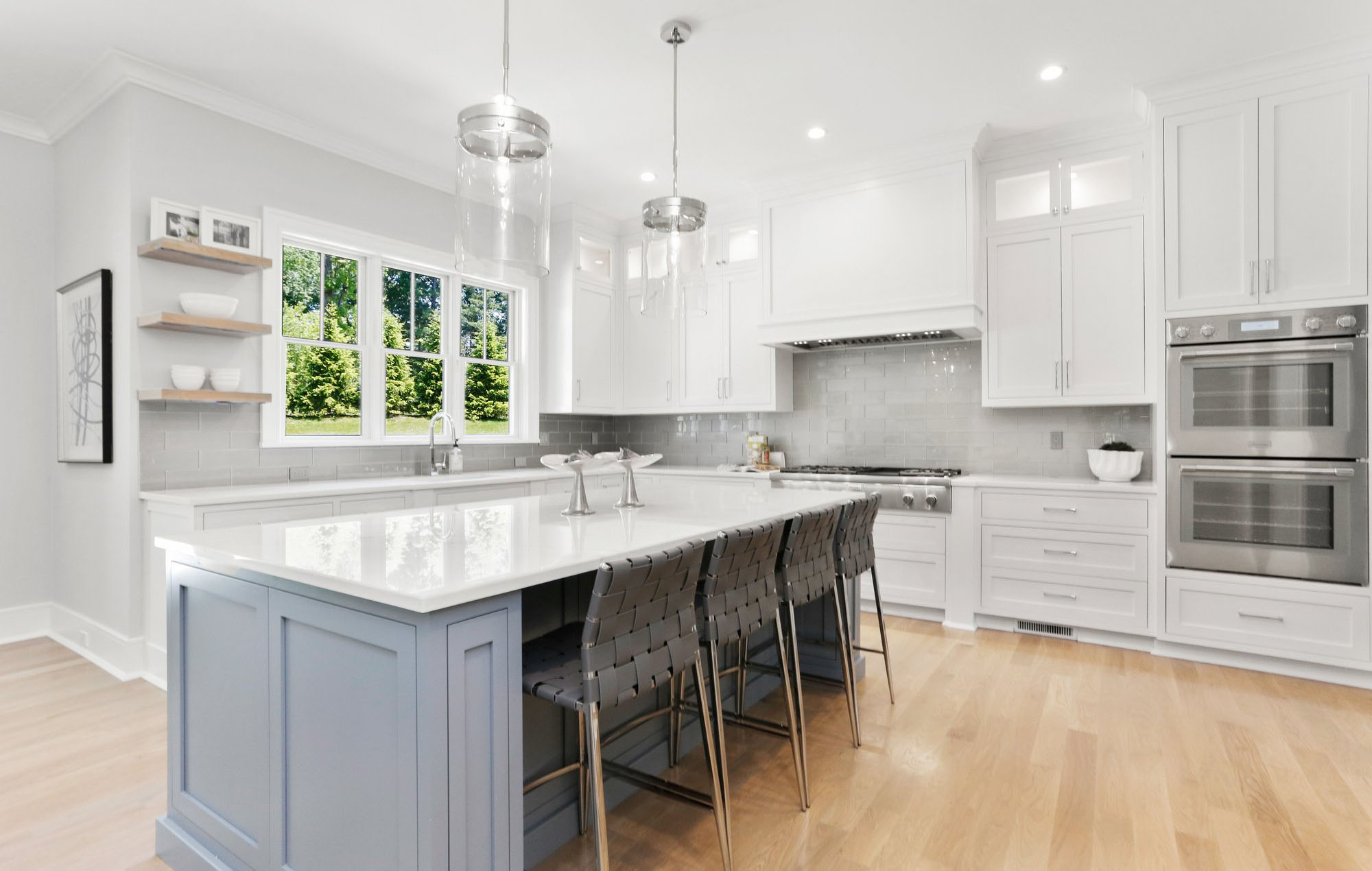 Here's another view of this beautiful kitchen. The two tone cabinet design adds contrast and keeps the kitchen from looking too pale.