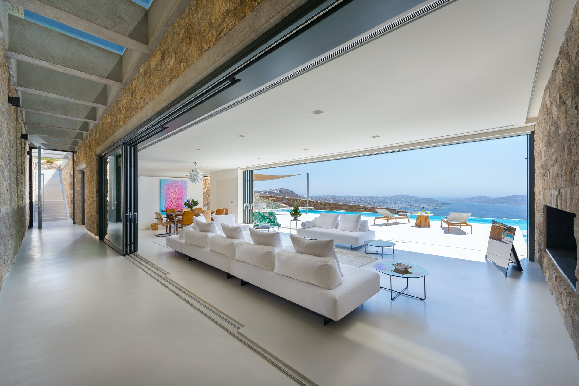 Recessed gliding patio doors create true indoor/outdoor living spaces. custom modern home Mykonos Greece