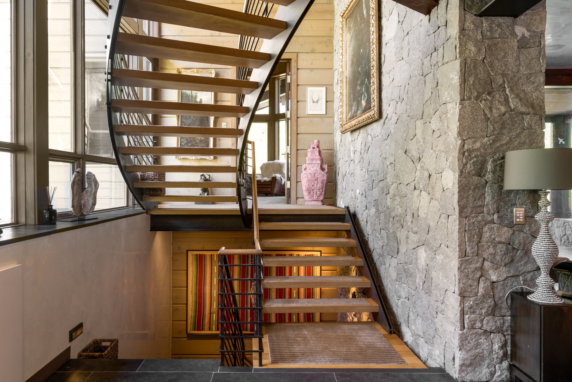 Because this is a modern rustic home it has an open riser stair design. It's been custom built to match the homes aesthetic.