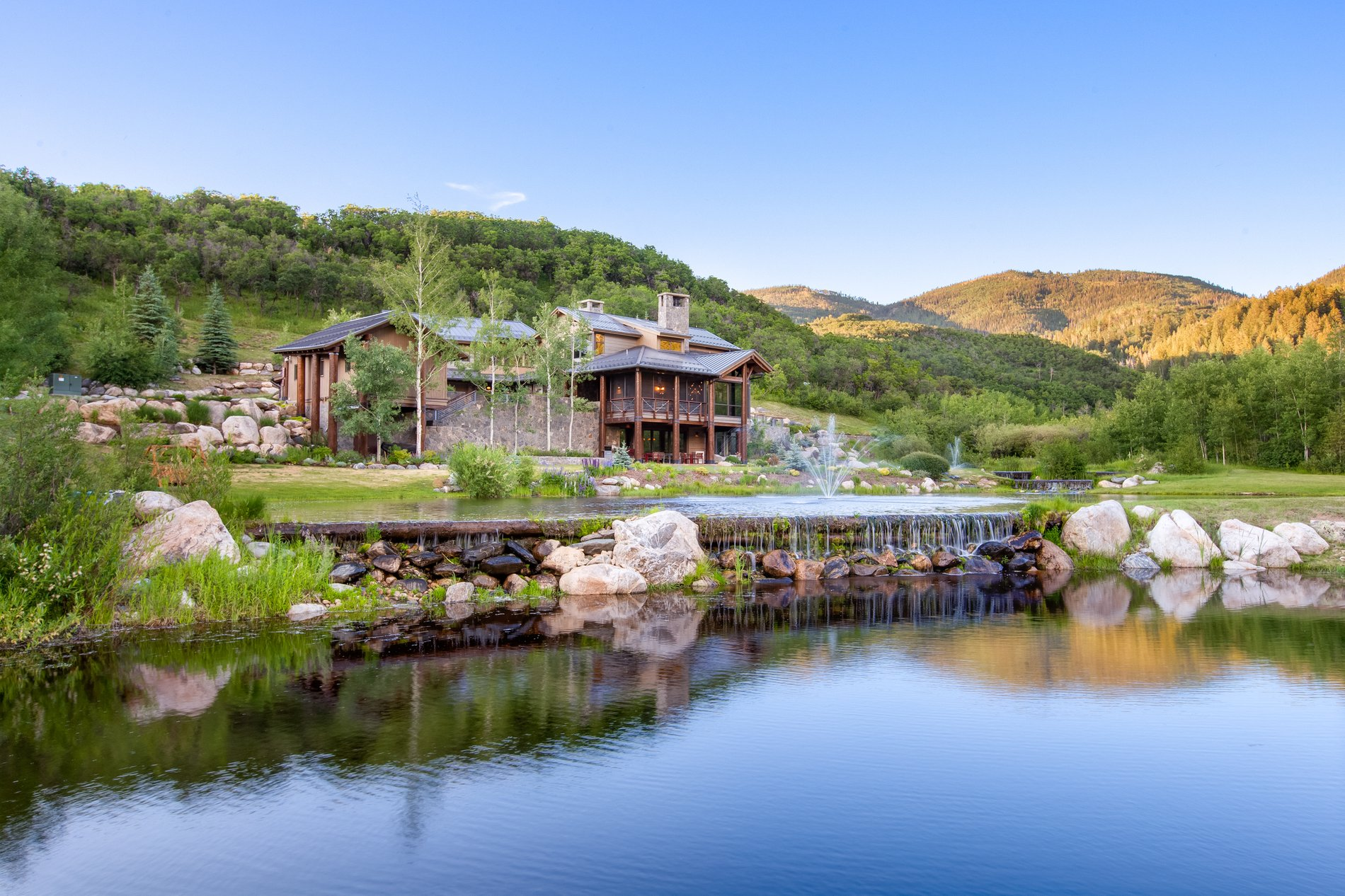 Lakeside view of this beautiful Colorado countryside home.