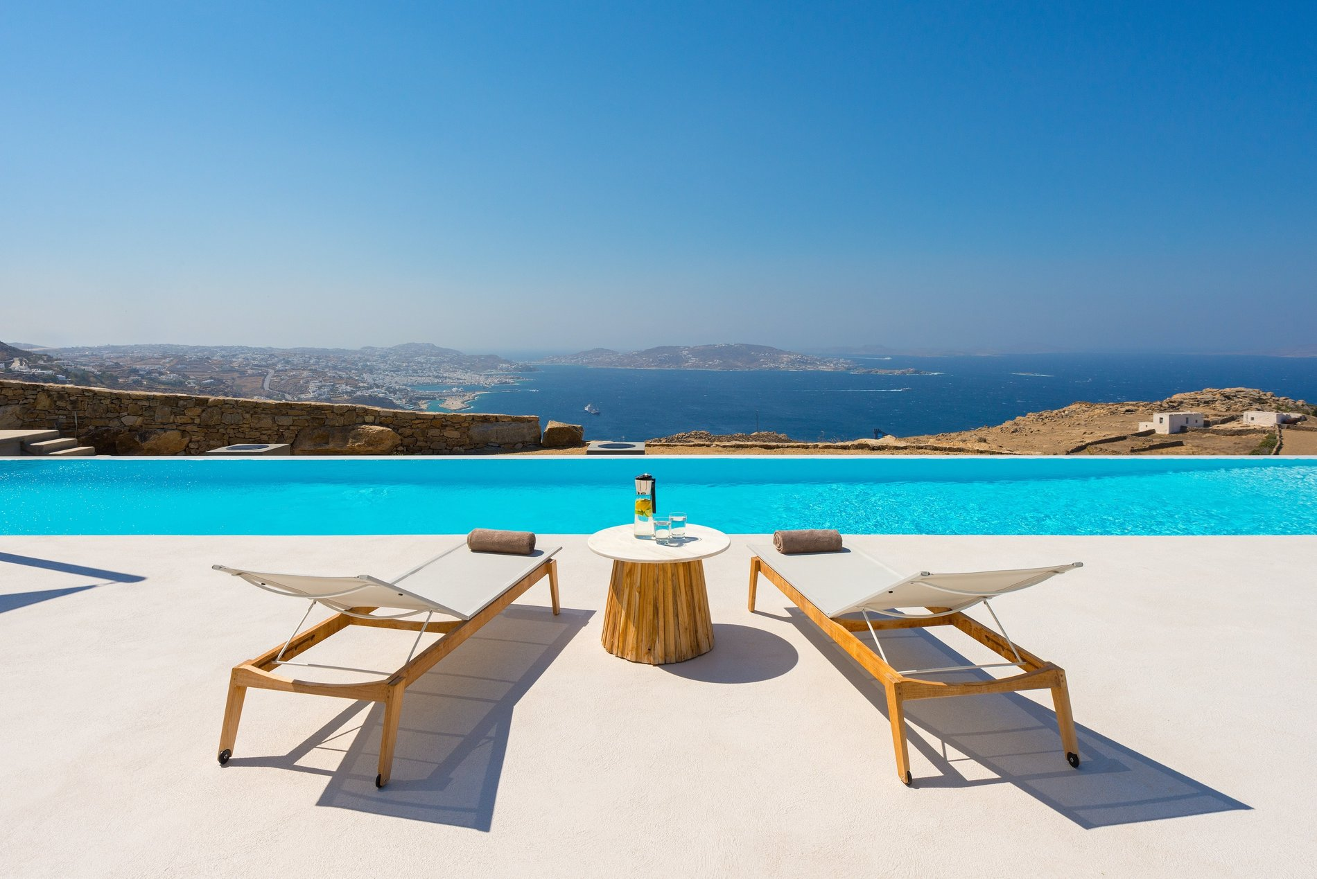 Modern Greek Home Mykonos. Sitting area poolside overlooking Greece.