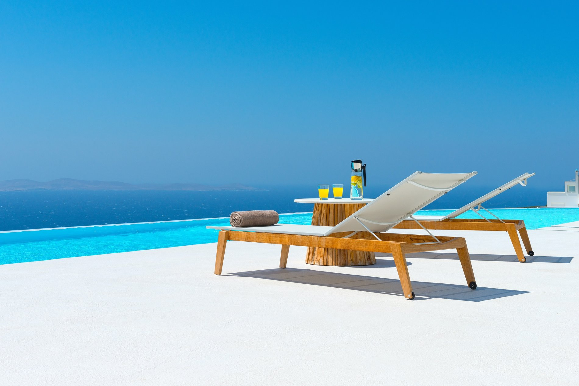 Poolside seating. view from the infinty edge pool of Greece.