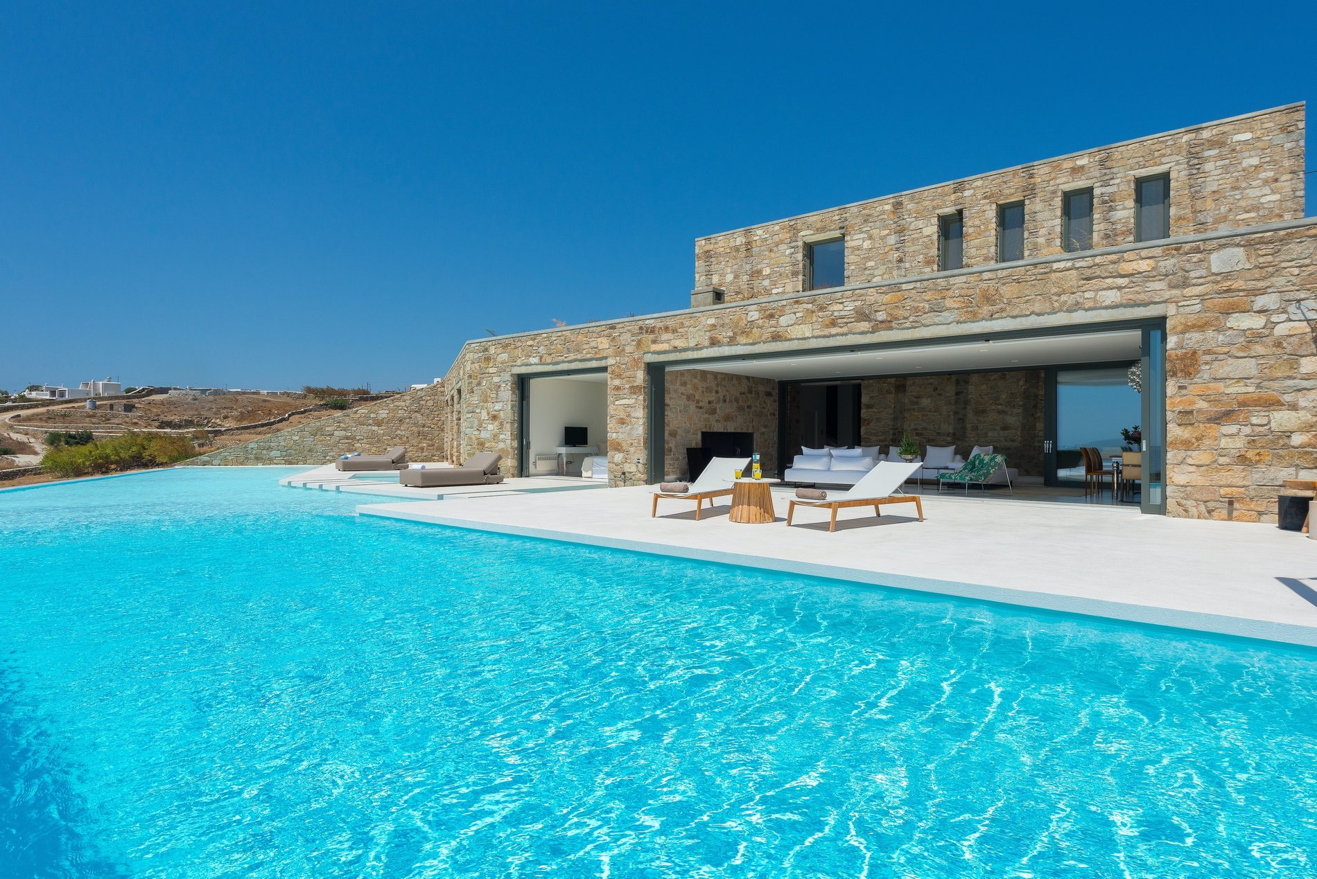 View from the huge infinity pool of this beautiful Modern home in Mykonos, Greece.