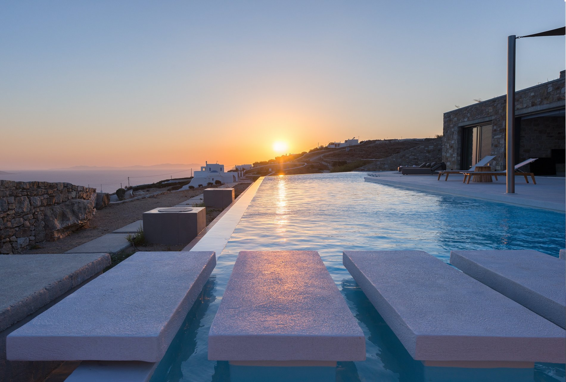 Sunset view from the infinity edge pool and floating stairs.