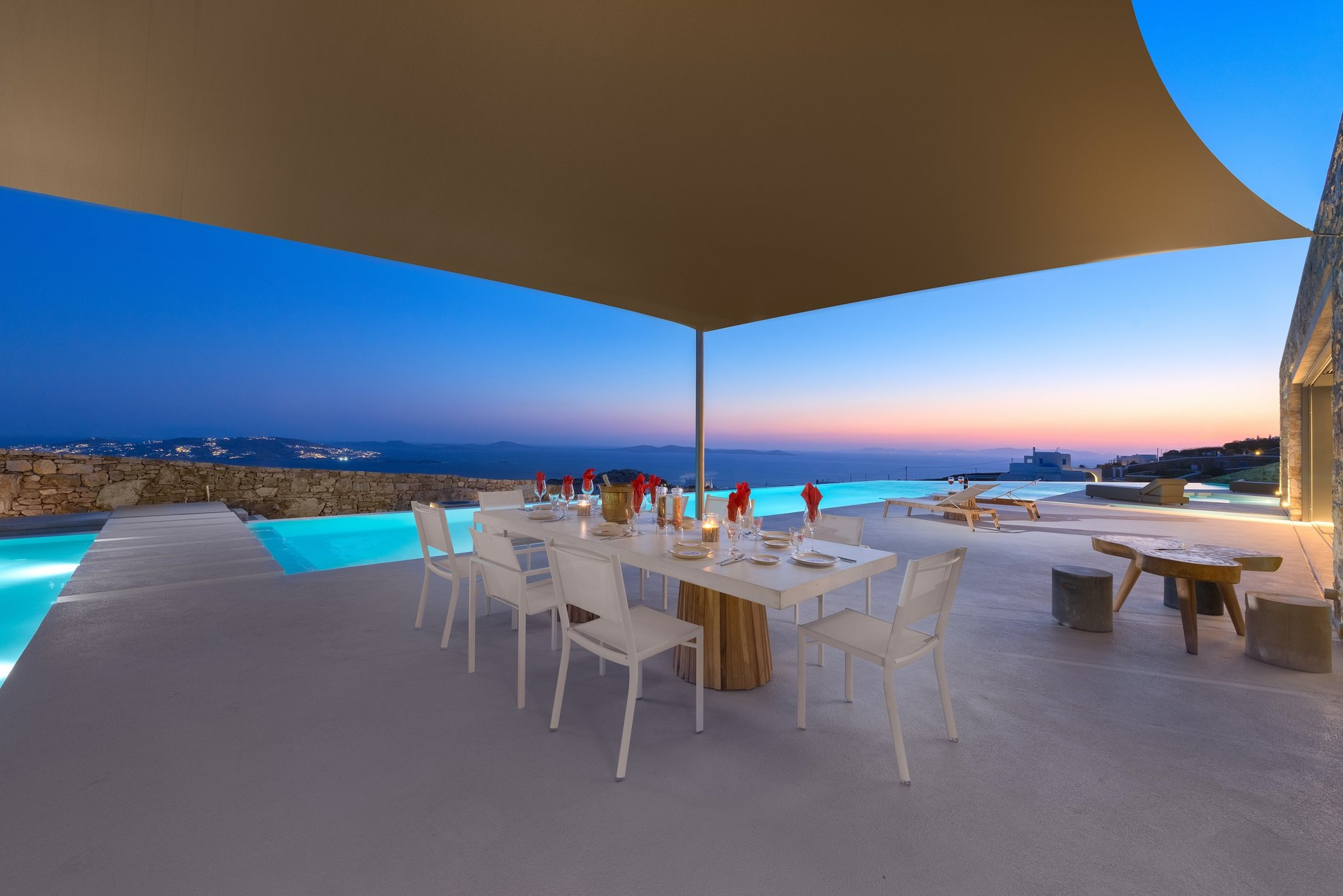 Sunset on the cement patio overlooking Mykonos, Greece.