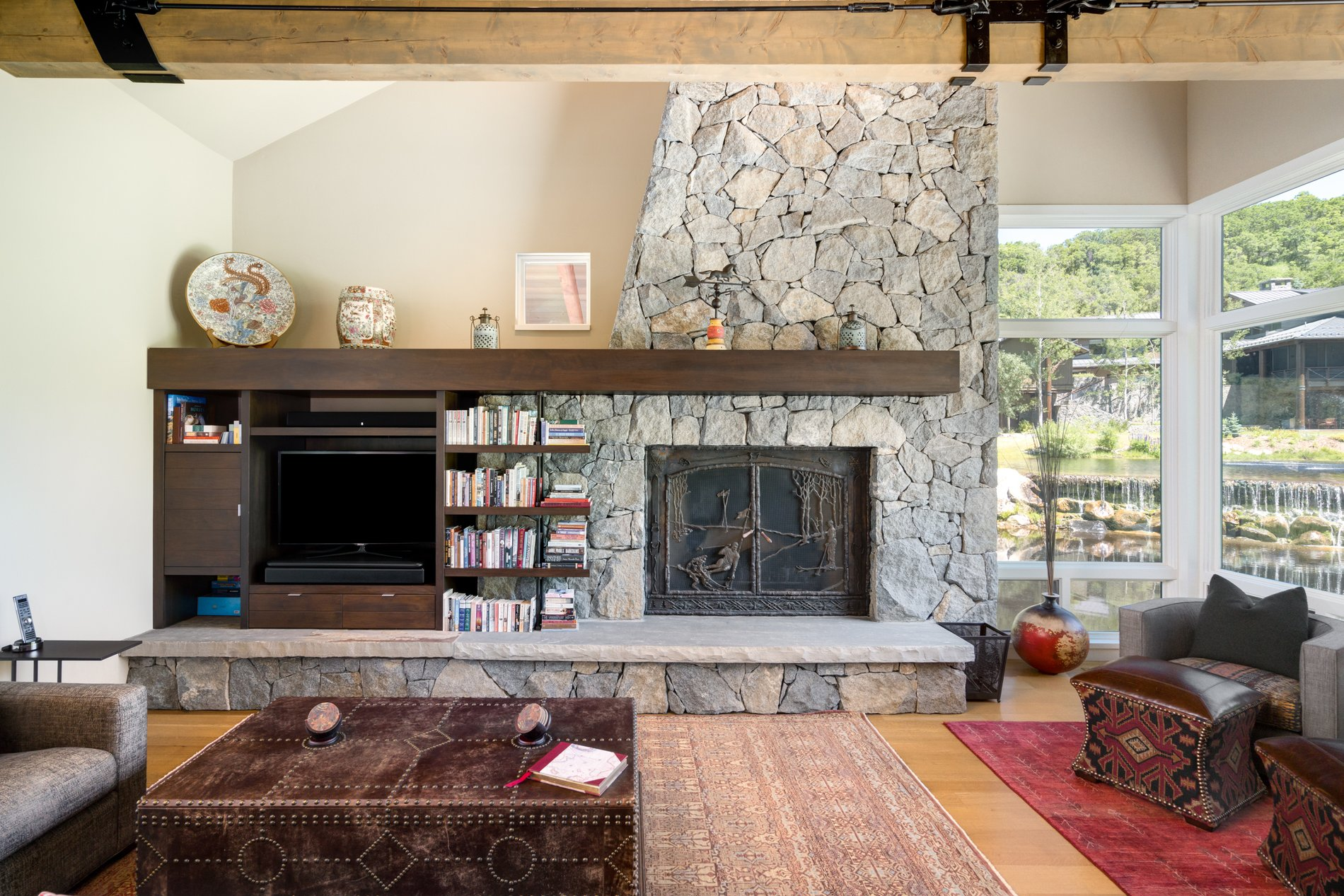 Wood burning fireplace with stone surround.