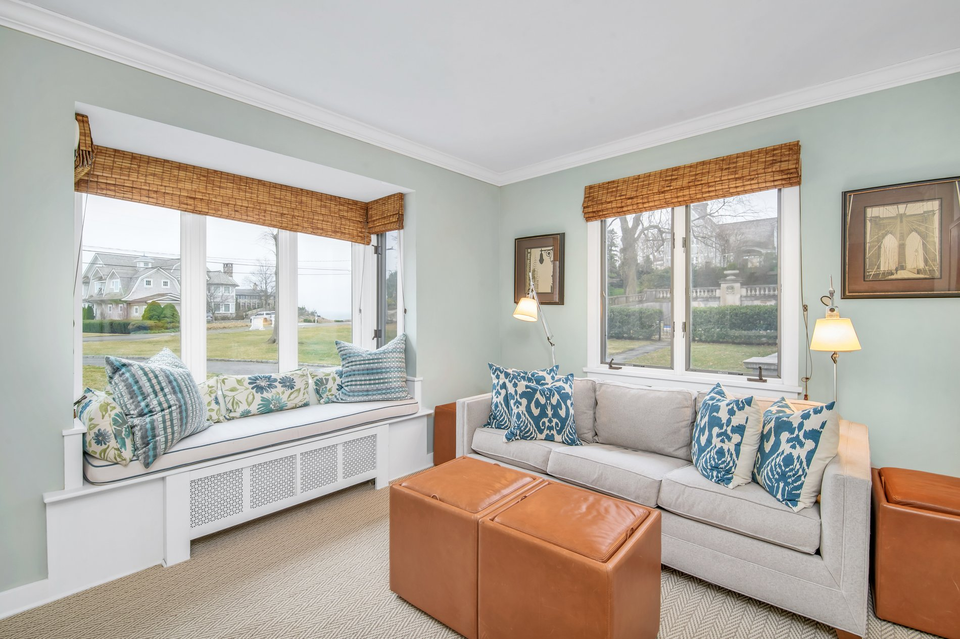 Living room with a window seat built above a radiator. cushion & pillows match the sofa.