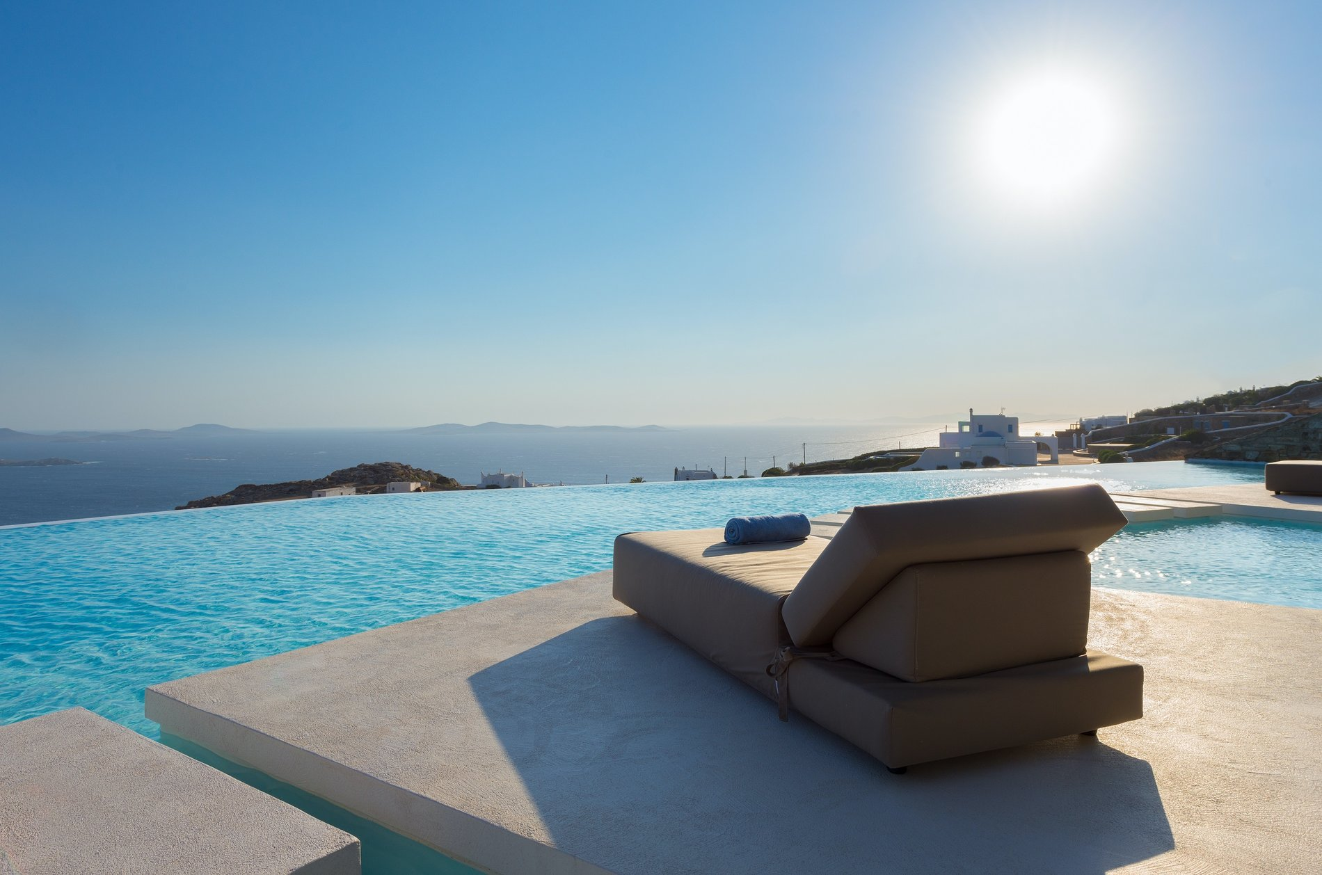 Modern Greek Home Mykonos. Poolside view of greece. infinity edge pool.