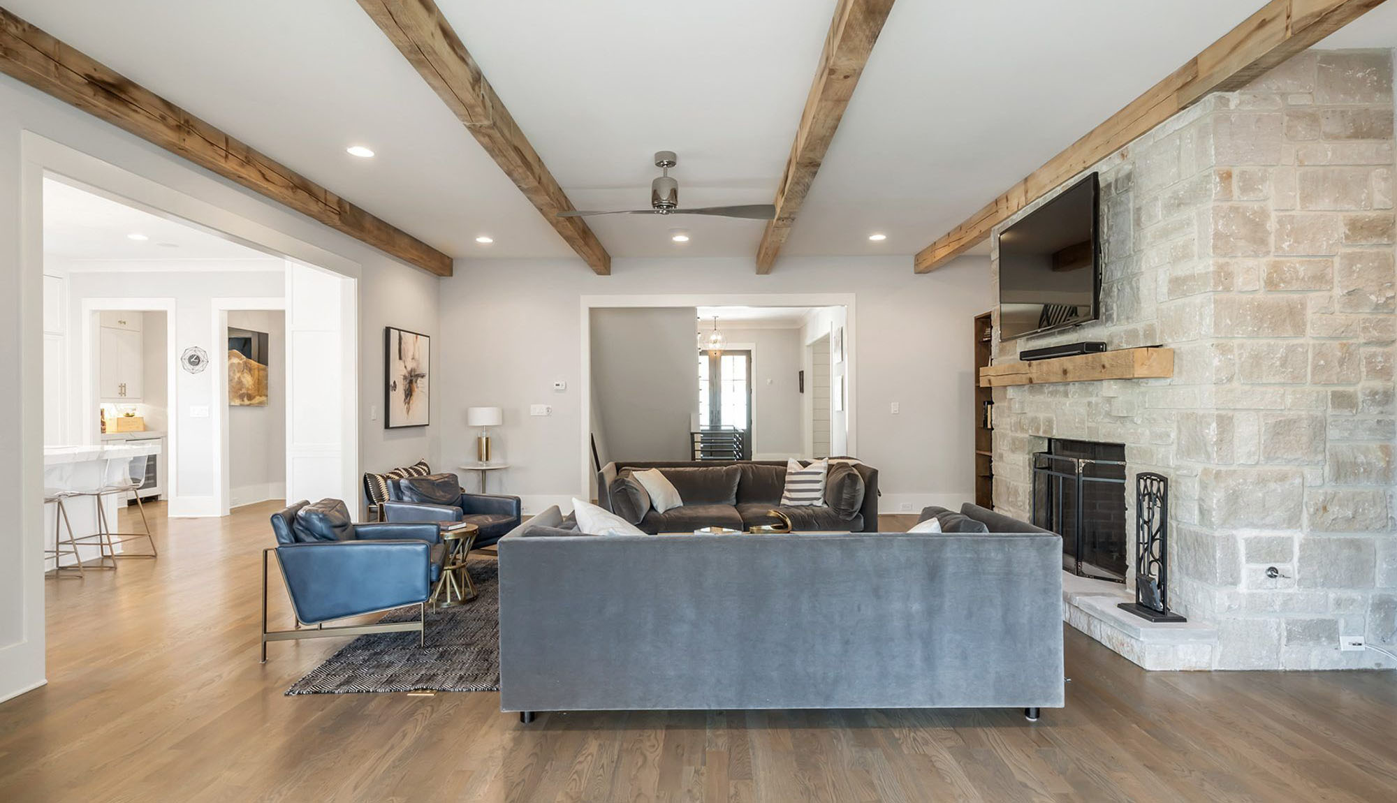 Bleached exposed ceiling beams to match the light grayish wood floors.