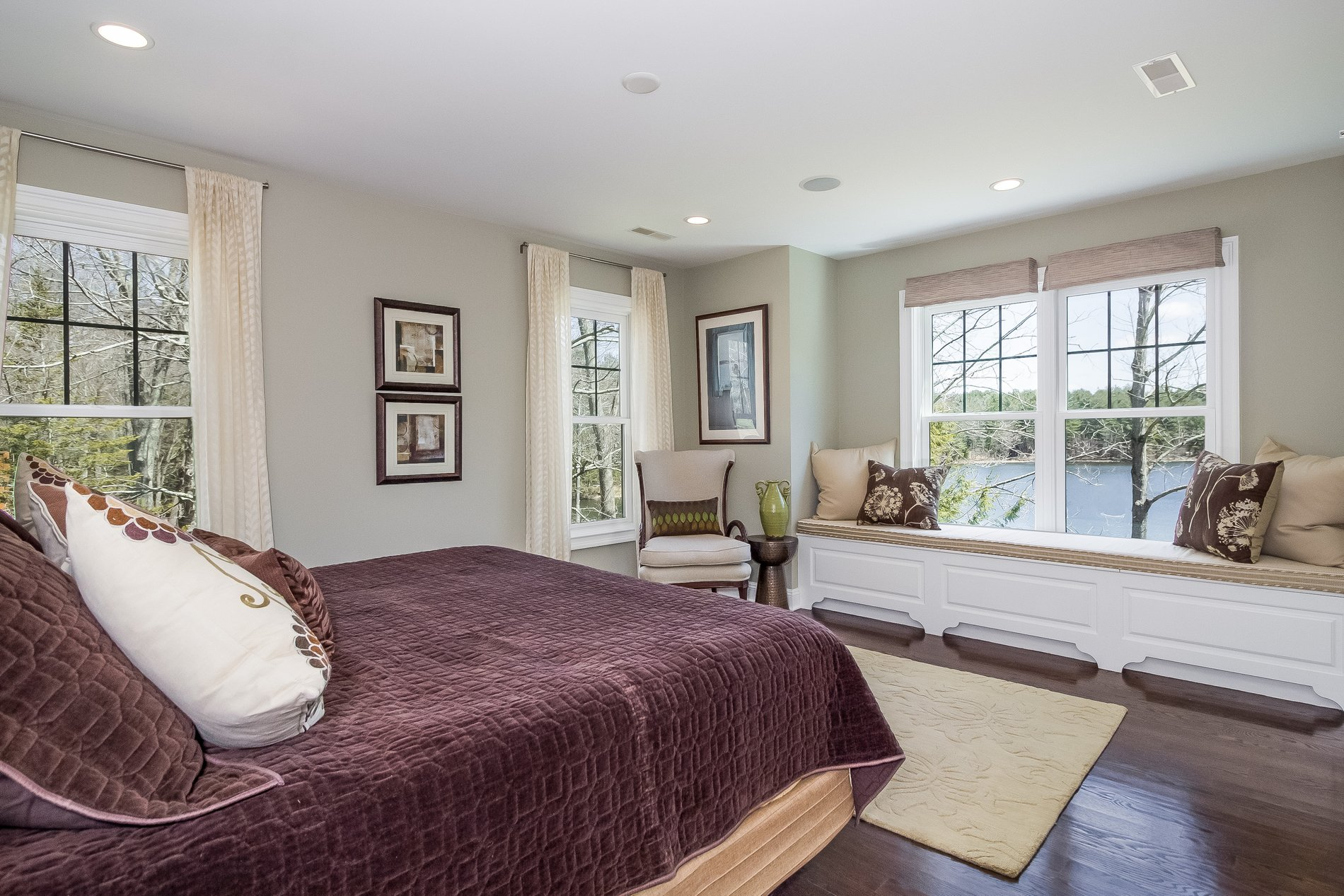 Master bedroom with a large window seat overlooking the river.
