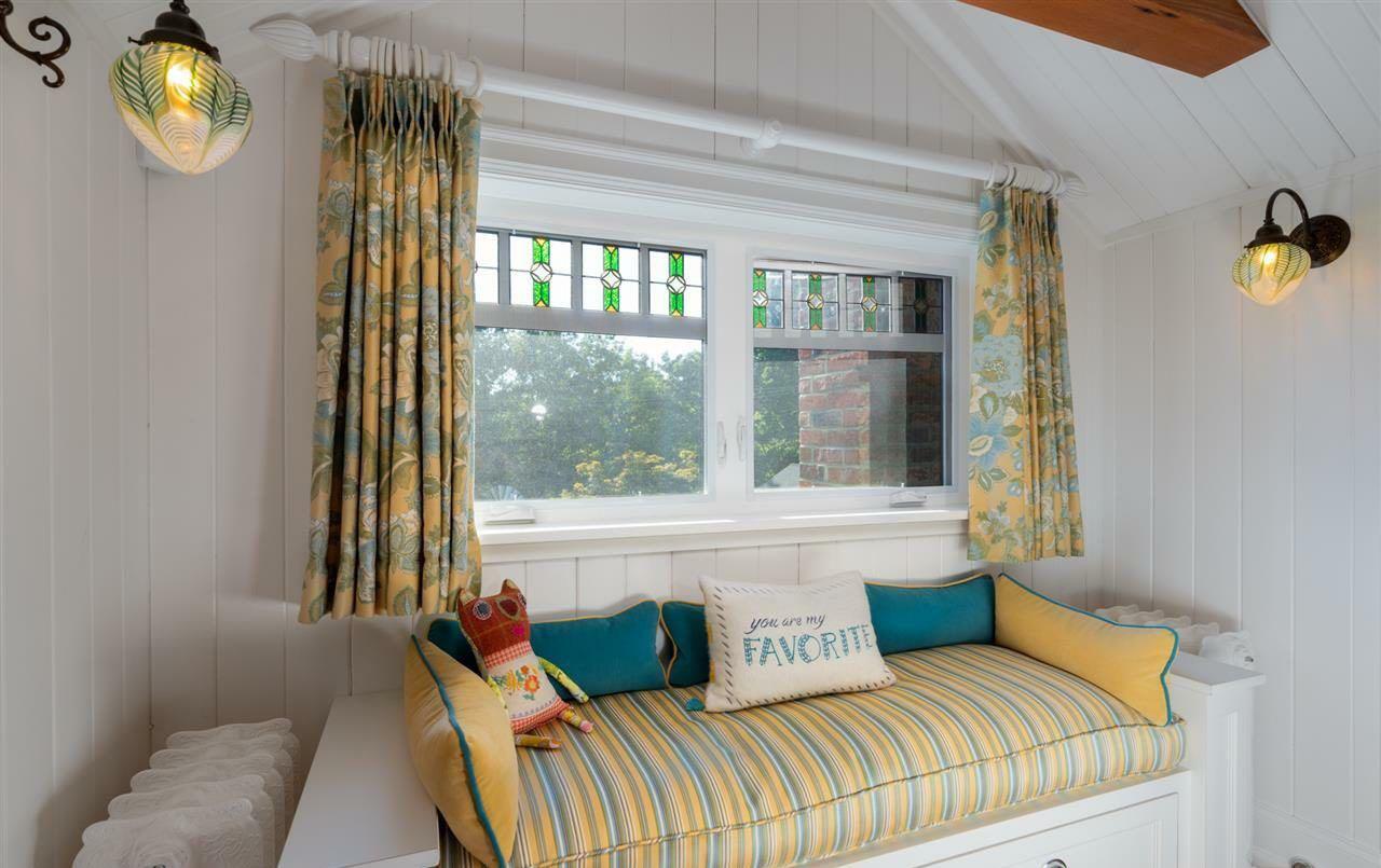 Cute little window seat in a child's bedroom.