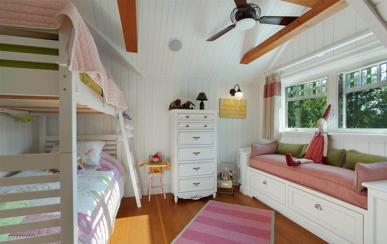 Window bench seat in a child's bedroom with pull out drawers.