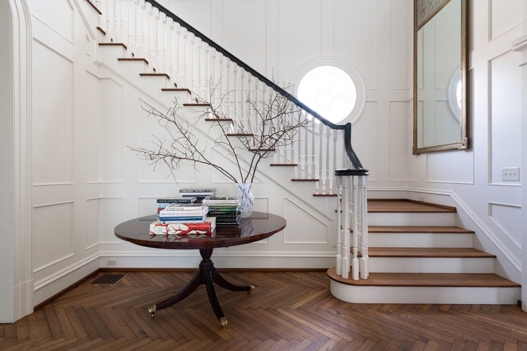 Beautiful herringbone hardwood floors with a medium brown stain and eggshell finish.