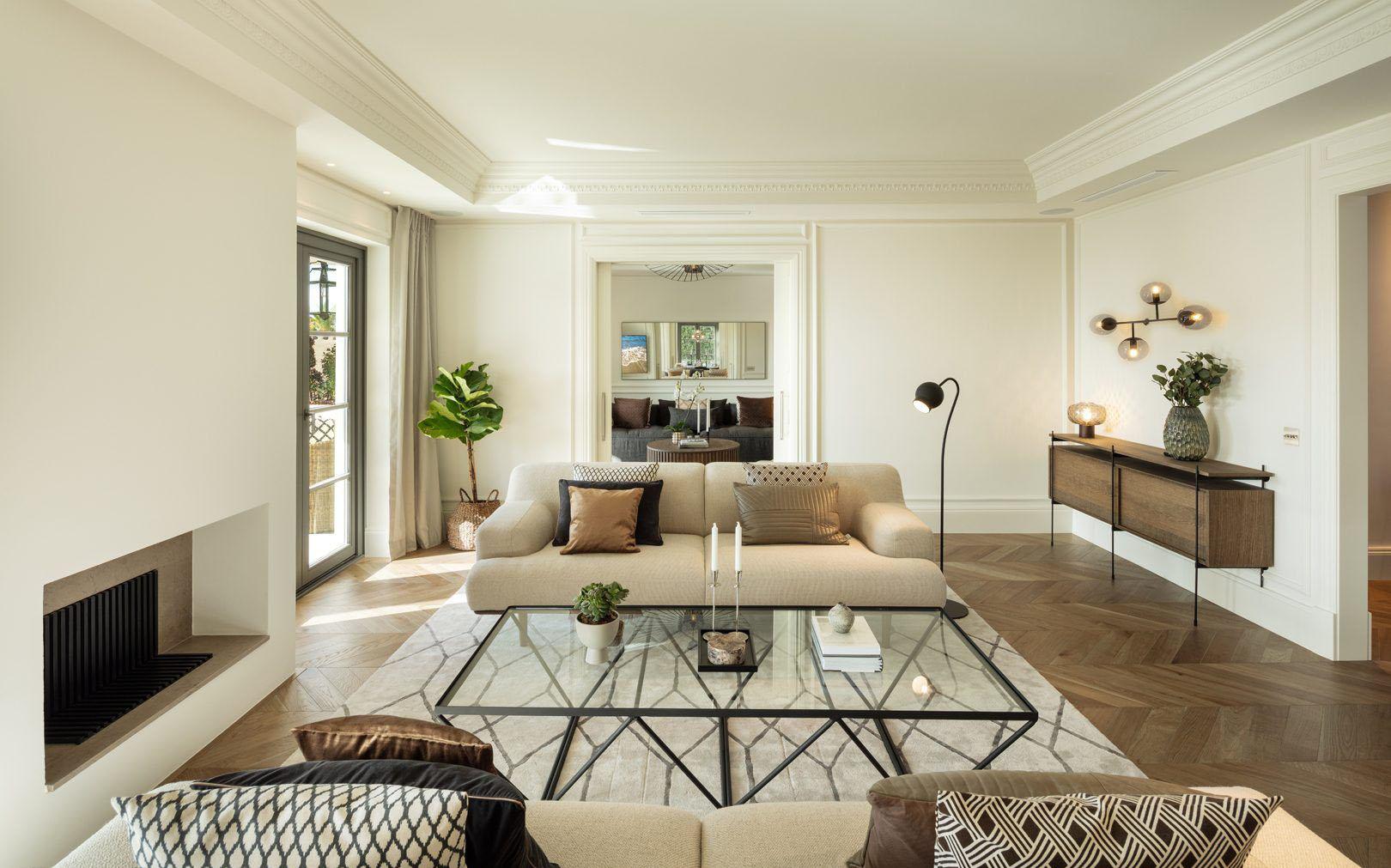 Beautiful living room with hardwood floors laid with a herringbone pattern.