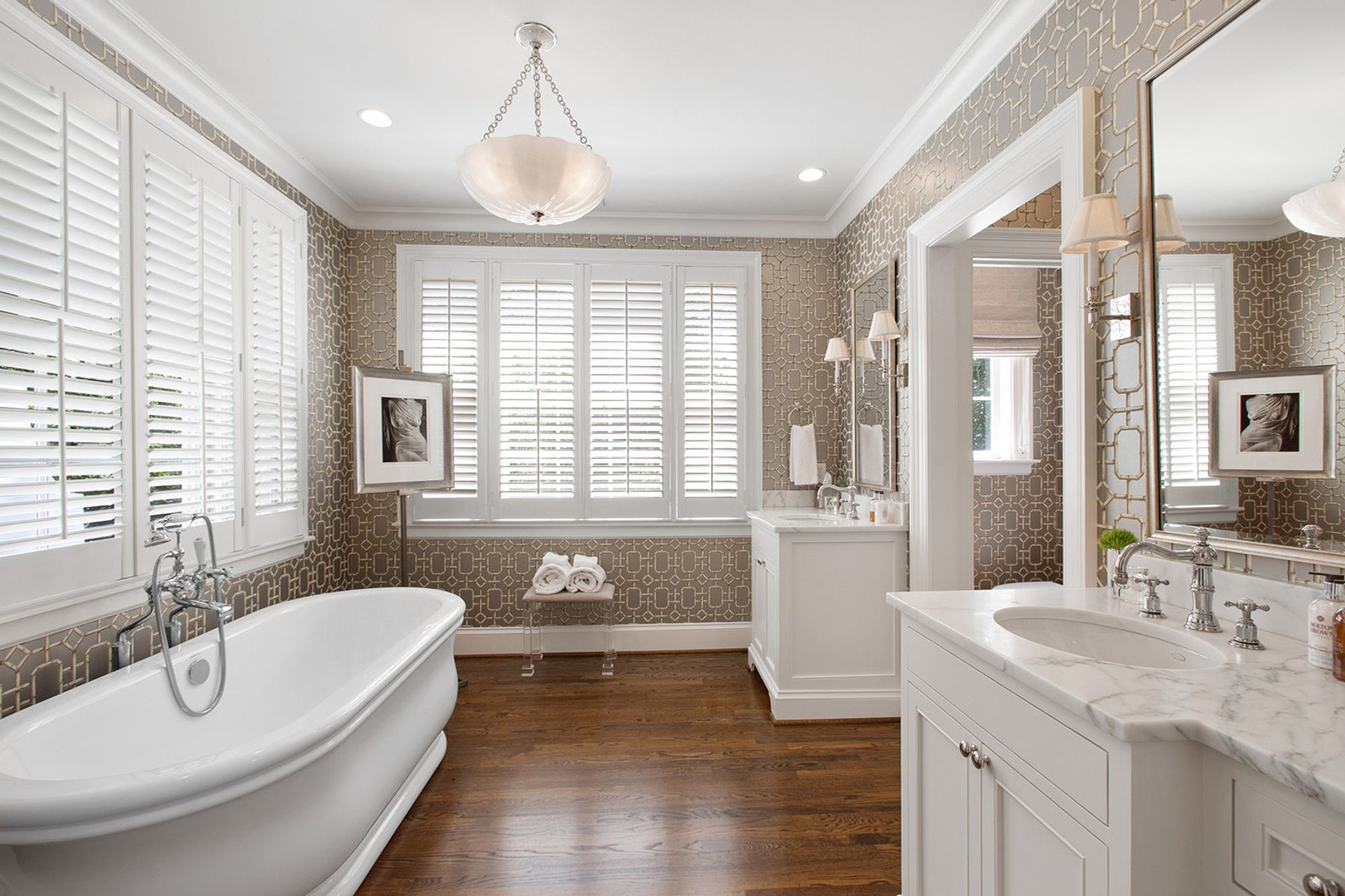 Master bathroom with hardwood floors stained a warm brown and finished with an egg shell sheen.