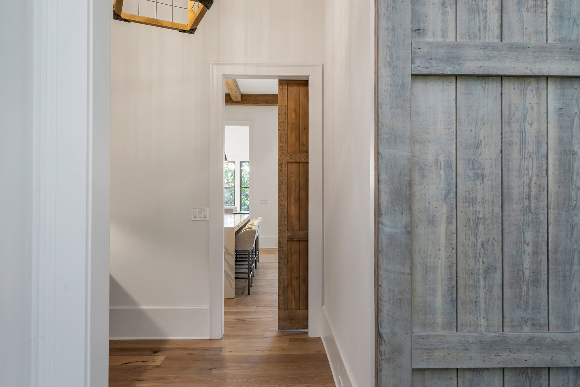 Bleached sliding barn wood doors to match the light and natural wood floors.