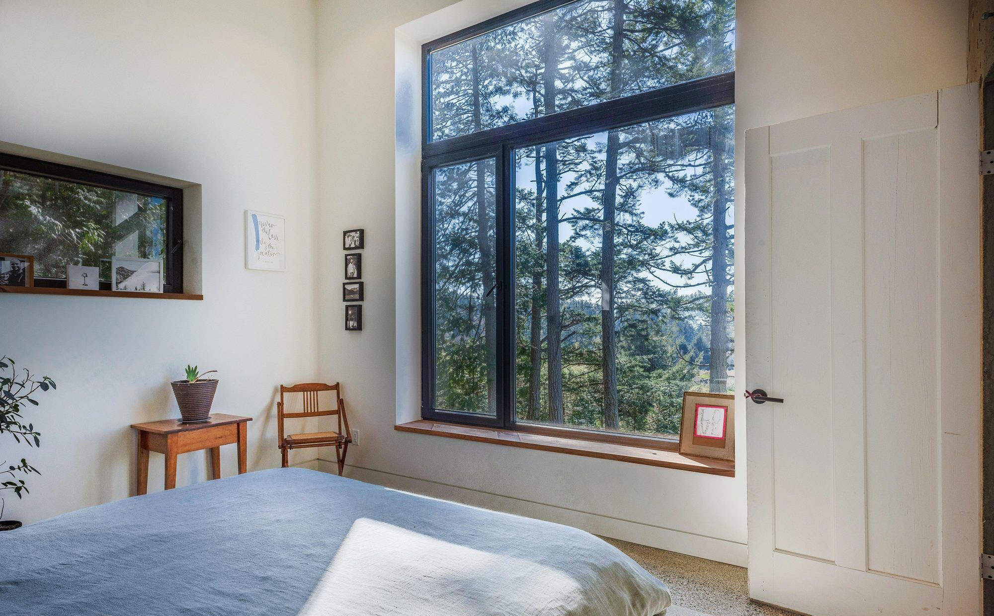 Bedroom with a very simple wooden window seat.