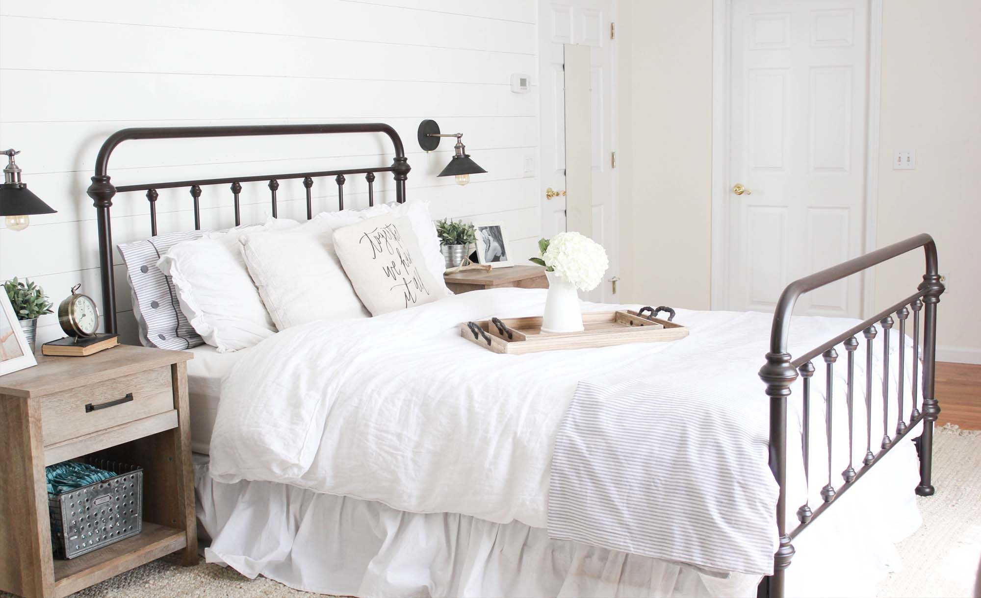 Modern farmhouse style bedroom with shiplap painted Alabaster white by Sherwin Williams.